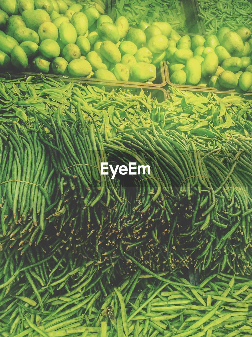 Directly Above View Of Fresh Green Vegetables At Market Stall