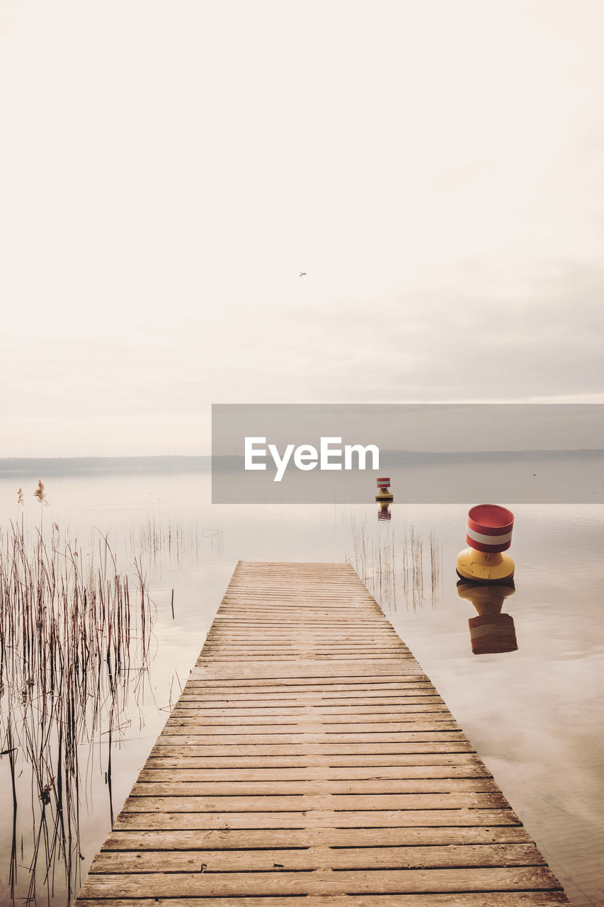 water, pier, wood - material, sky, direction, the way forward, sea, tranquil scene, tranquility, scenics - nature, nature, beauty in nature, jetty, horizon over water, no people, horizon, idyllic, day, outdoors, wood paneling, long, wooden post