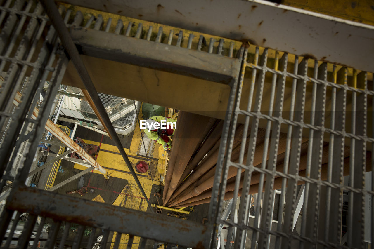 LOW ANGLE VIEW OF ABANDONED BUILDING IN OLD METAL STRUCTURE