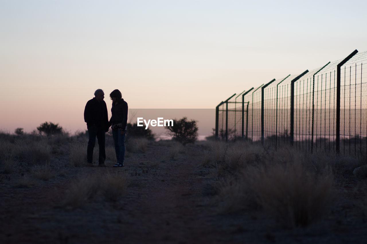 Couple On Rocky Field