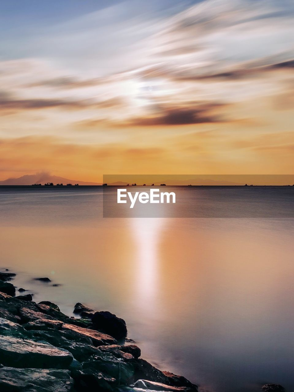 water, sky, beauty in nature, scenics - nature, cloud - sky, tranquility, sunset, sea, tranquil scene, nature, idyllic, no people, reflection, beach, rock, orange color, land, horizon, horizon over water, outdoors
