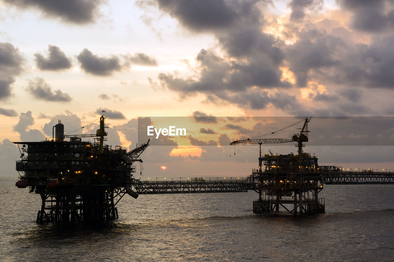 sky, cloud - sky, water, sea, sunset, industry, fuel and power generation, offshore platform, fossil fuel, oil industry, drilling rig, waterfront, nature, oil, no people, gasoline, built structure, orange color, business, horizon over water, outdoors, industrial equipment