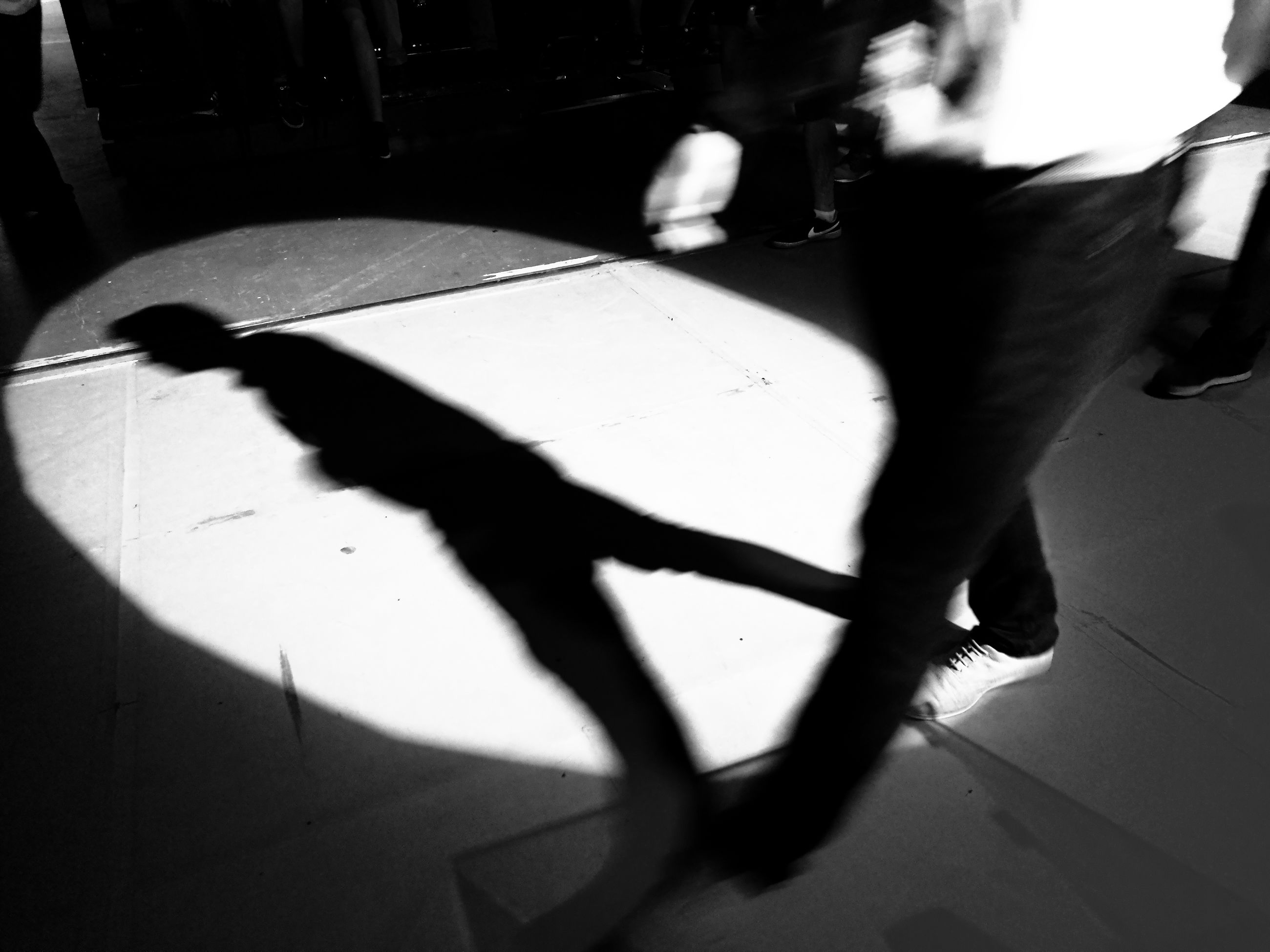 shadow, real people, sunlight, low section, walking, one person, lifestyles, day, standing, indoors, people
