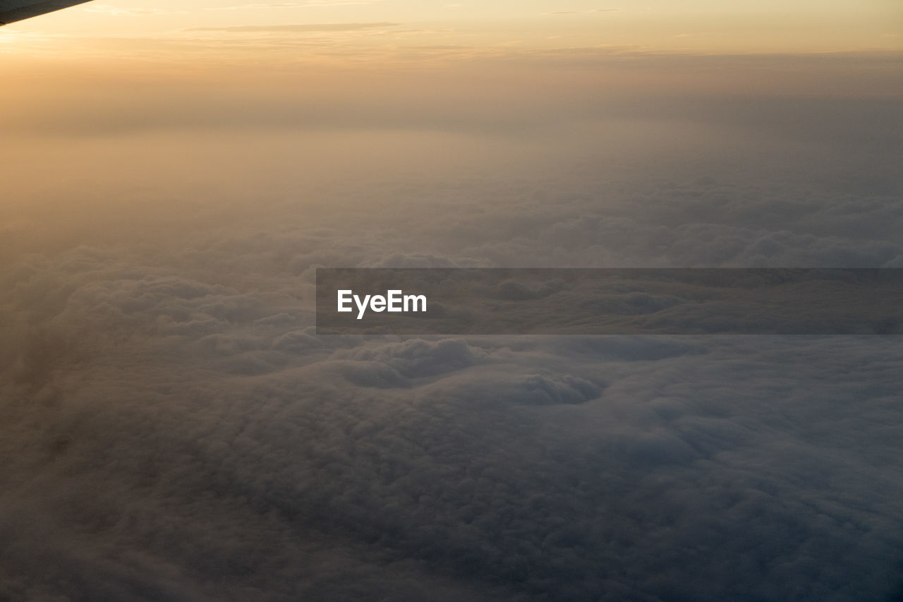 beauty in nature, sky, scenics - nature, cloud - sky, sunset, tranquility, tranquil scene, idyllic, no people, nature, aerial view, cloudscape, outdoors, non-urban scene, softness, day, orange color, high angle view, horizon