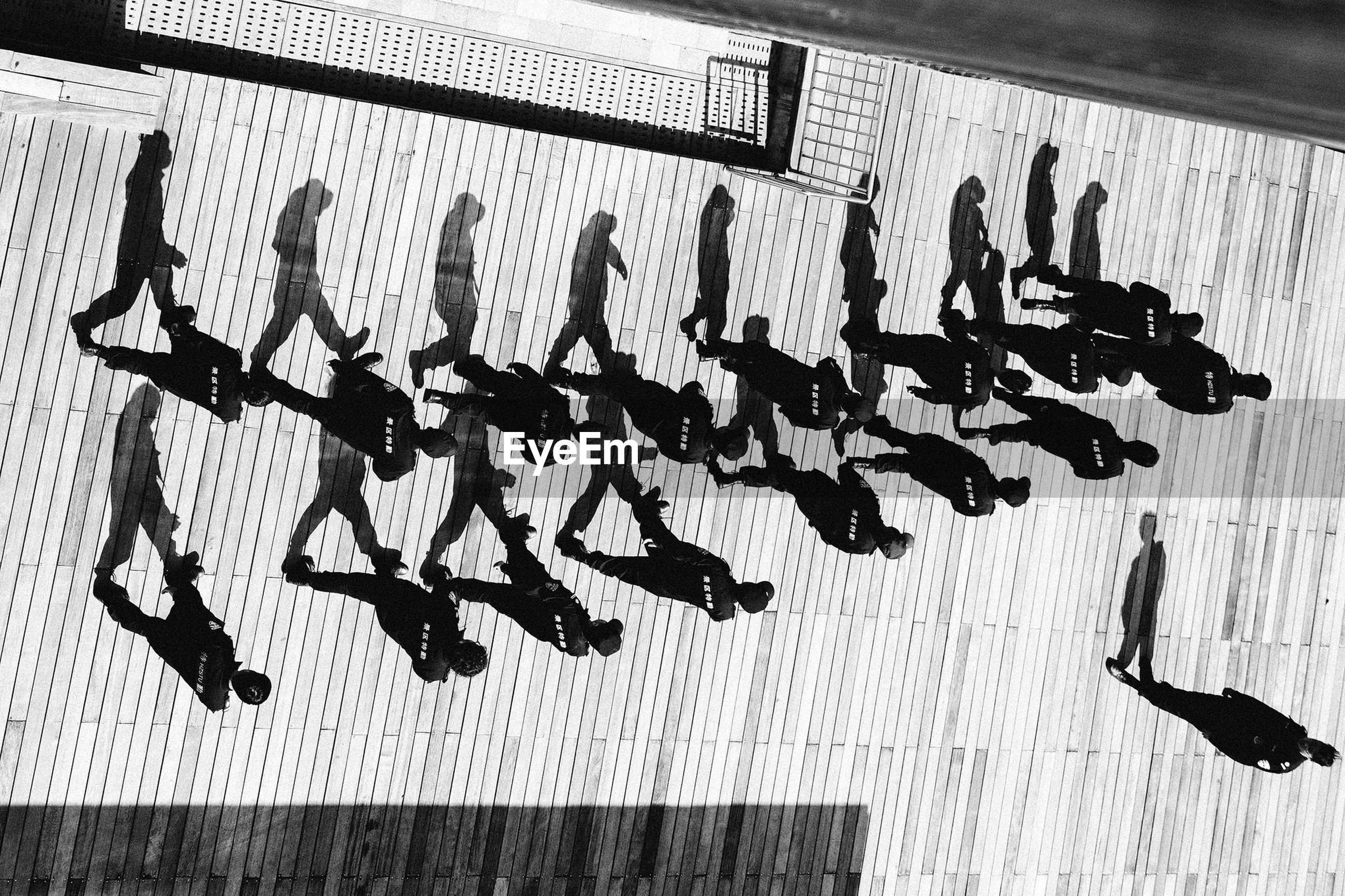 High angle view of police force marching on sunny day