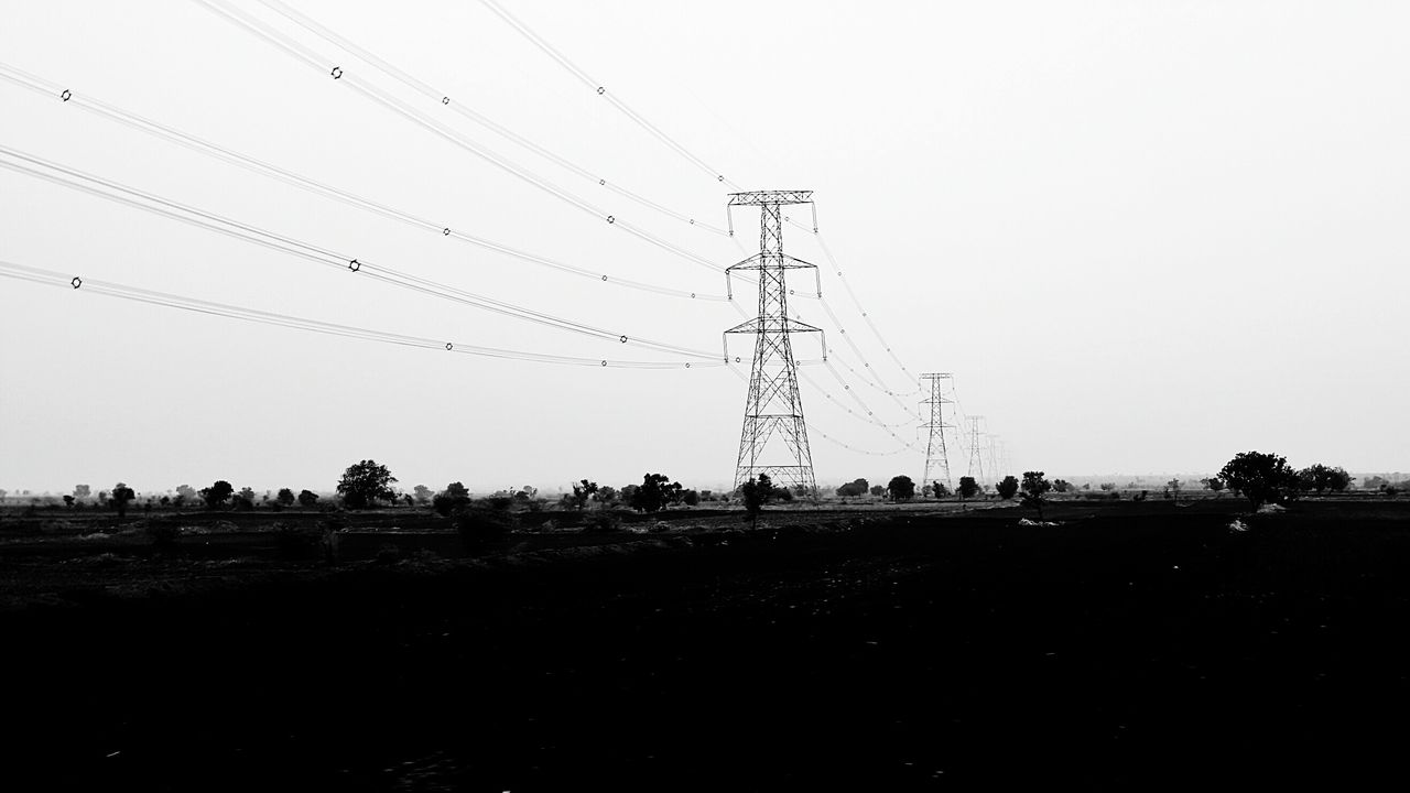 electricity pylon, cable, electricity, power line, power supply, connection, clear sky, fuel and power generation, electricity tower, field, landscape, technology, sky, no people, outdoors, nature, day, tree, grass, telephone line