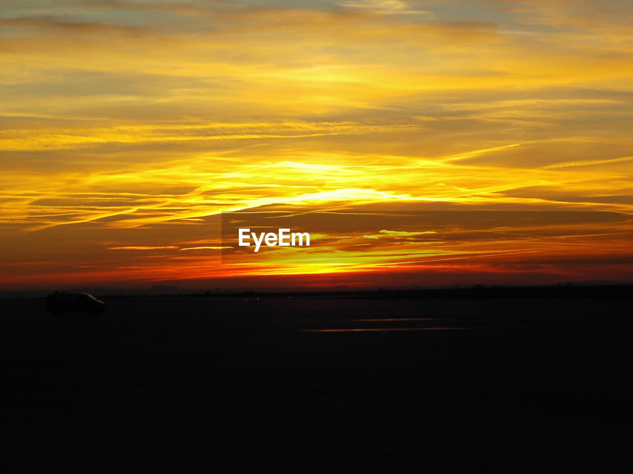 sunset, sky, cloud - sky, orange color, beauty in nature, scenics - nature, silhouette, tranquil scene, tranquility, no people, nature, environment, idyllic, landscape, dramatic sky, yellow, land, outdoors, field, horizon