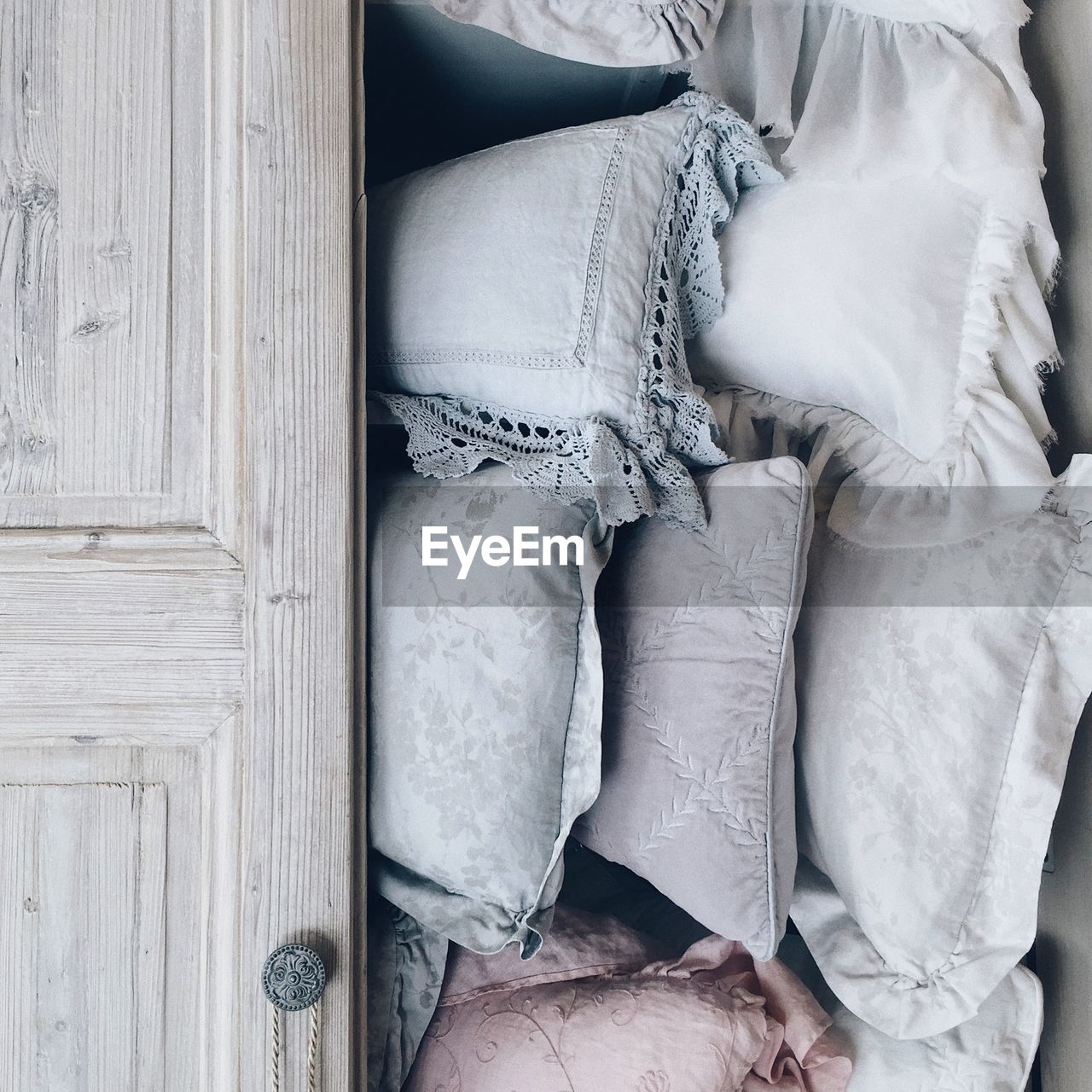 furniture, indoors, textile, no people, white color, high angle view, wood - material, clothing, close-up, pillow, still life, bed, fashion, directly above, day, collection, body part, jeans