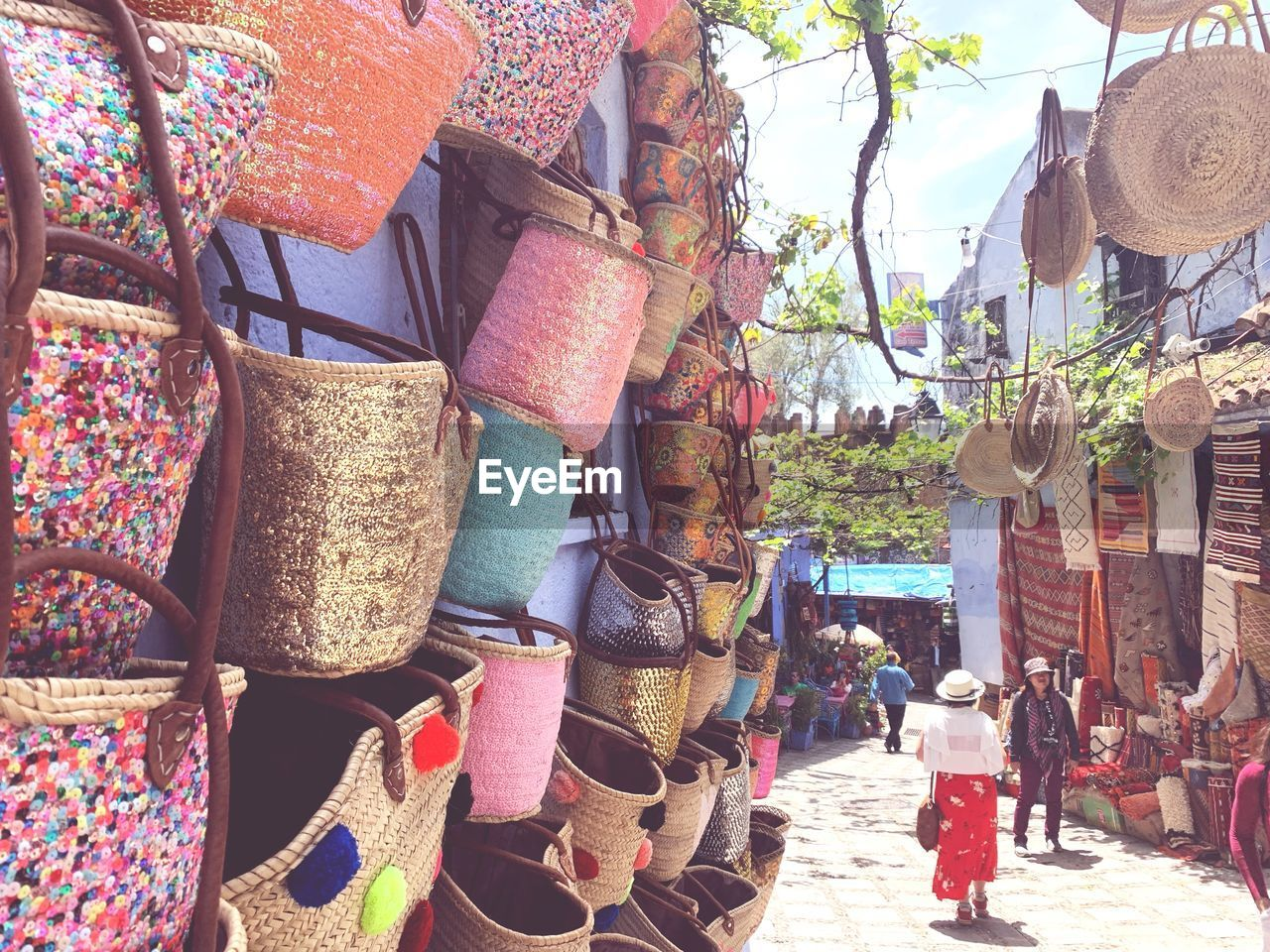 market, for sale, retail, day, choice, market stall, variation, hanging, architecture, building exterior, outdoors, built structure, small business, large group of objects, incidental people, nature, retail display, group, clothing, sale