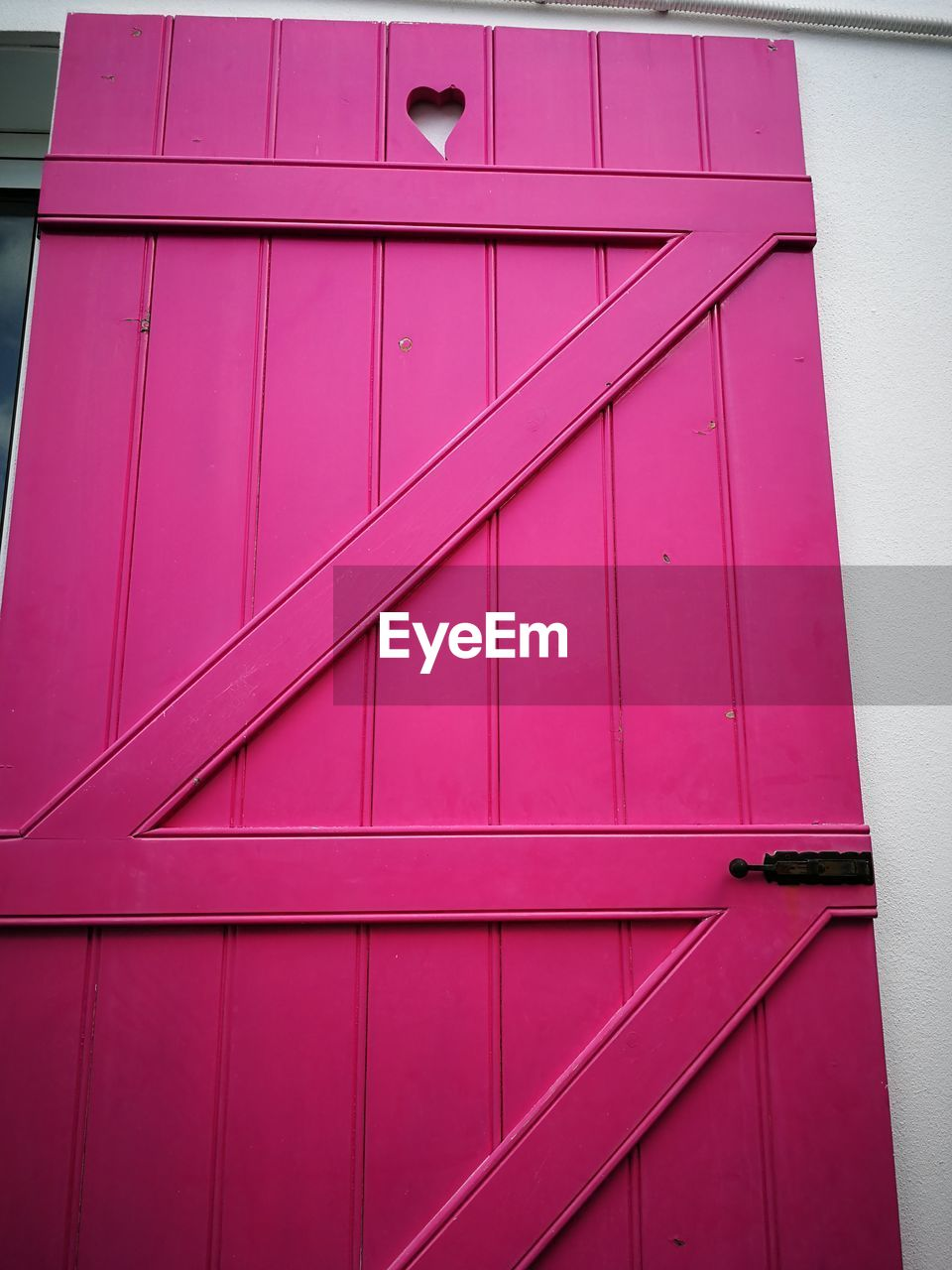 architecture, built structure, building exterior, pink color, no people, full frame, day, building, door, entrance, outdoors, closed, safety, security, pattern, protection, backgrounds, close-up, wall, low angle view