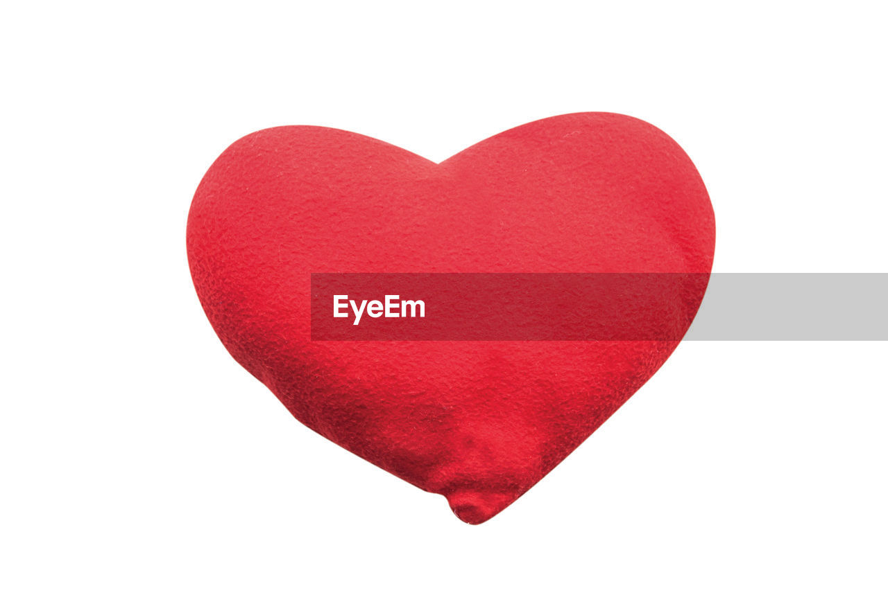 Close-up of red heart shape against white background