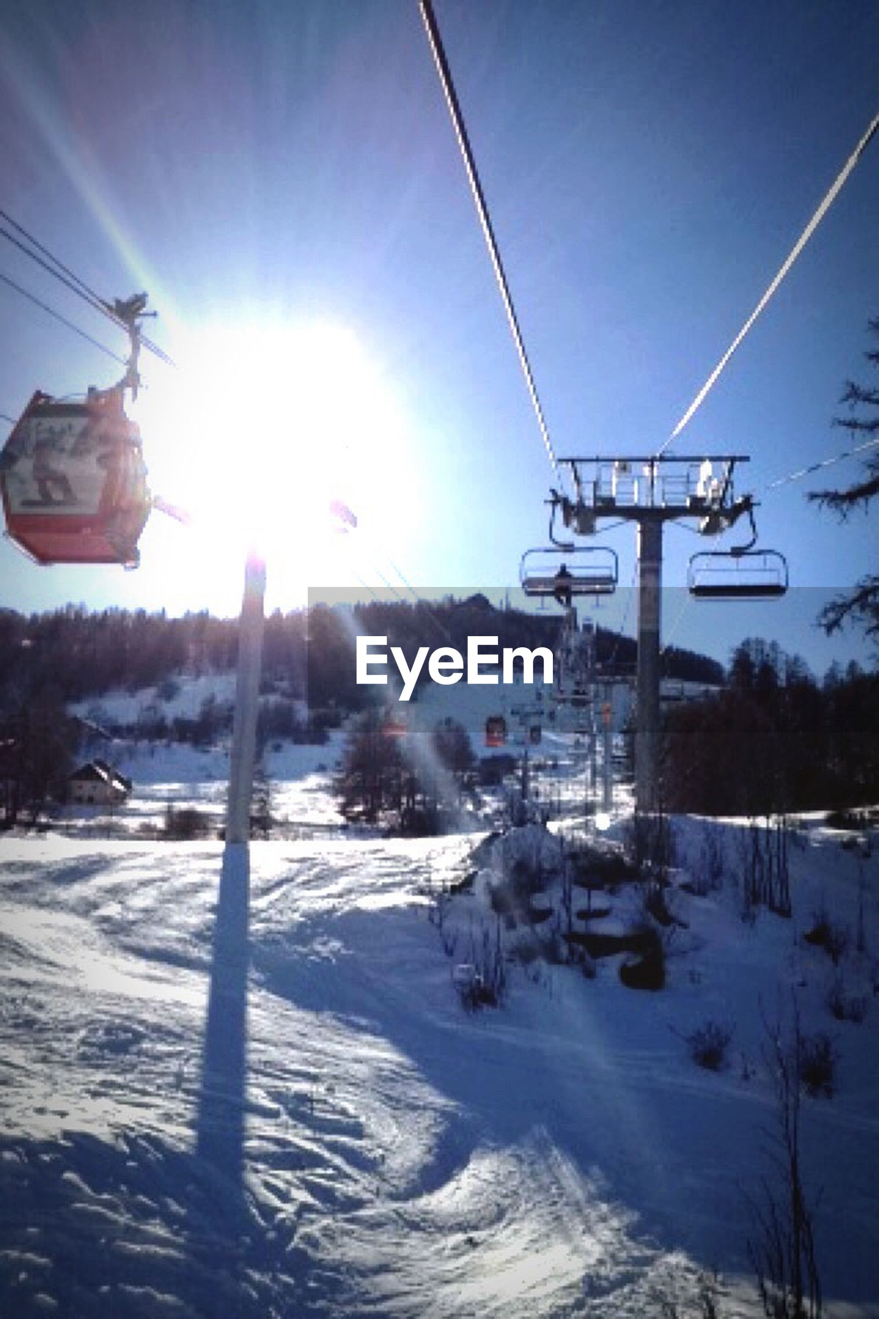 snow, winter, cold temperature, sun, season, sunbeam, sunlight, transportation, weather, lens flare, mode of transport, covering, clear sky, ski lift, sky, nature, bright, sunny, frozen, white color