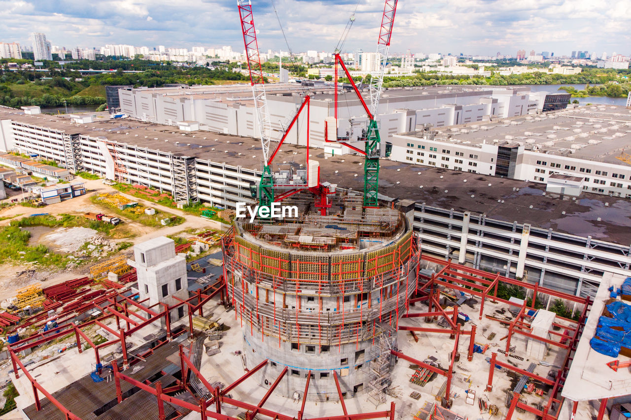 HIGH ANGLE VIEW OF BUILDINGS AT CONSTRUCTION SITE