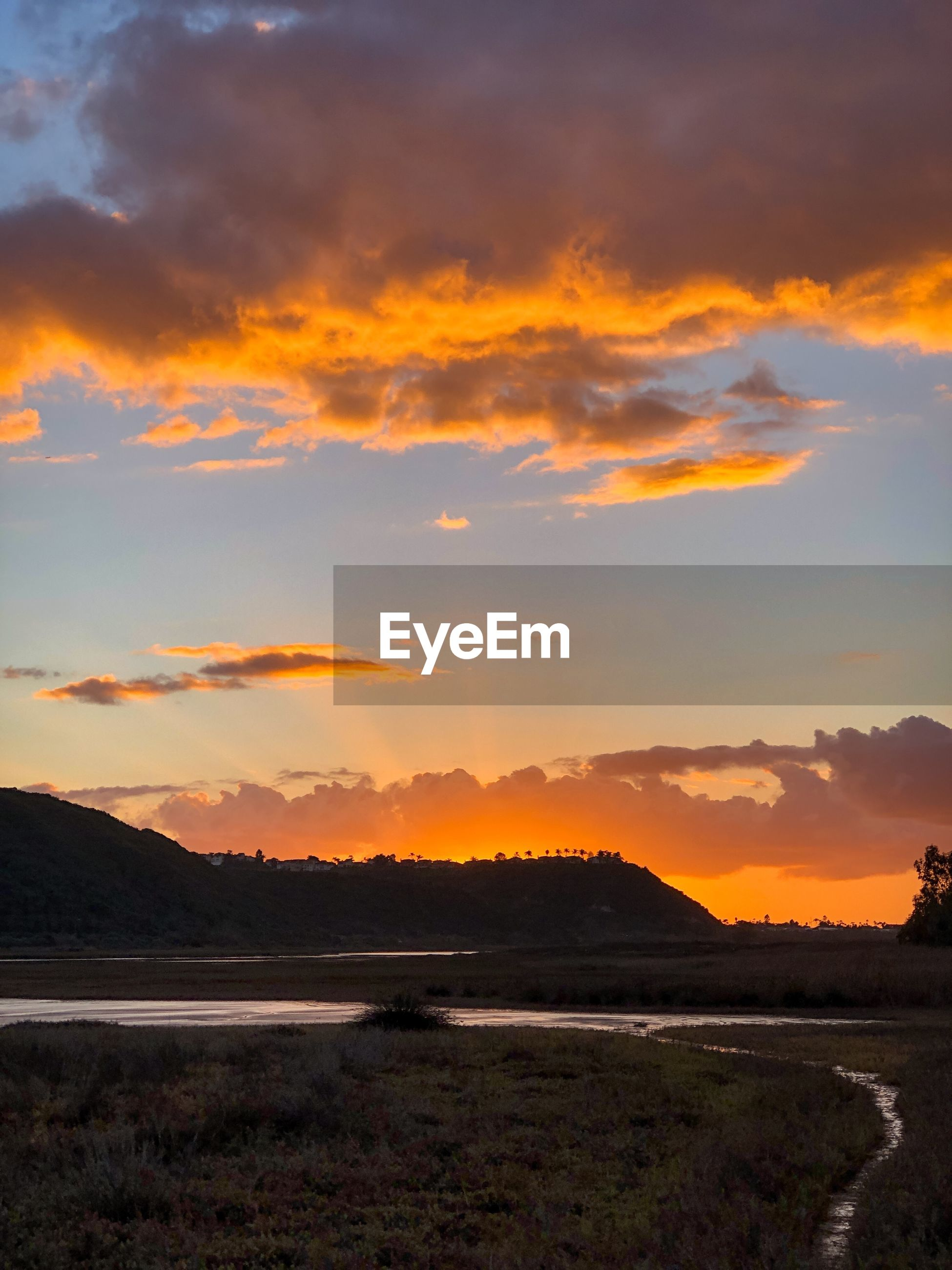 SCENIC VIEW OF SUNSET OVER LAND