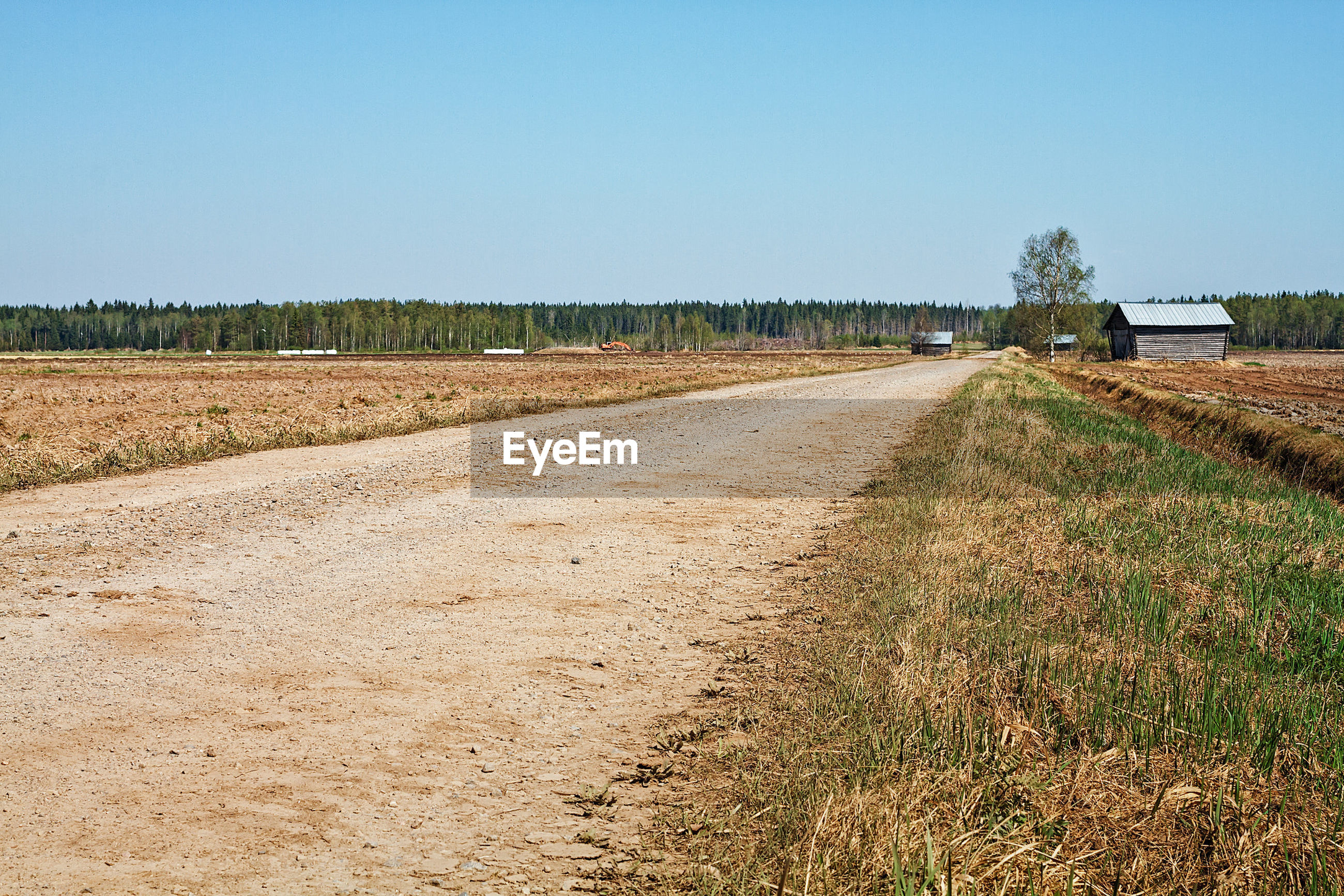 ROAD PASSING THROUGH AGRICULTURAL FIELD