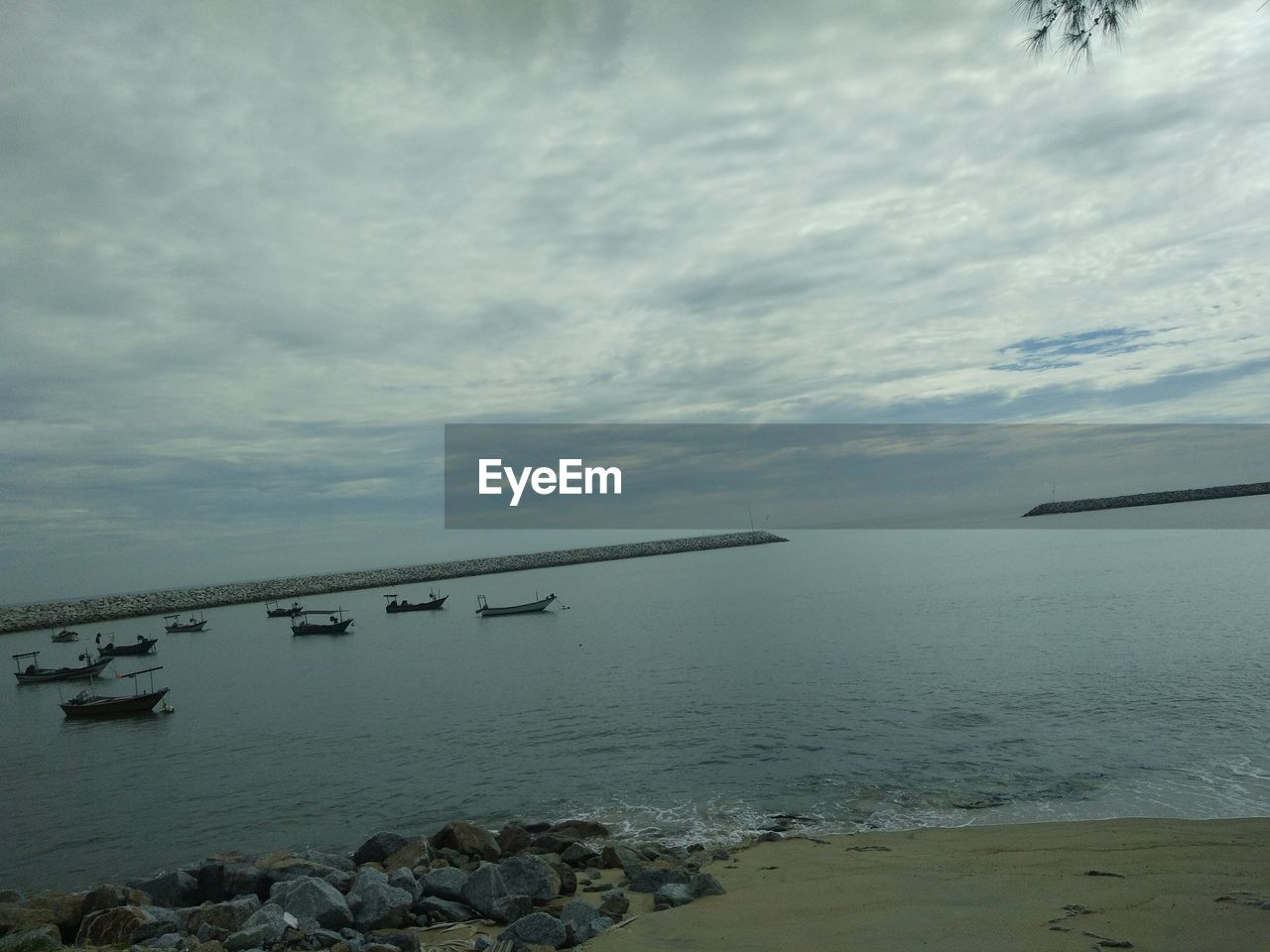 water, sky, cloud - sky, sea, beauty in nature, nature, scenics - nature, tranquil scene, tranquility, rock, beach, no people, day, land, horizon over water, rock - object, horizon, solid, outdoors, groyne