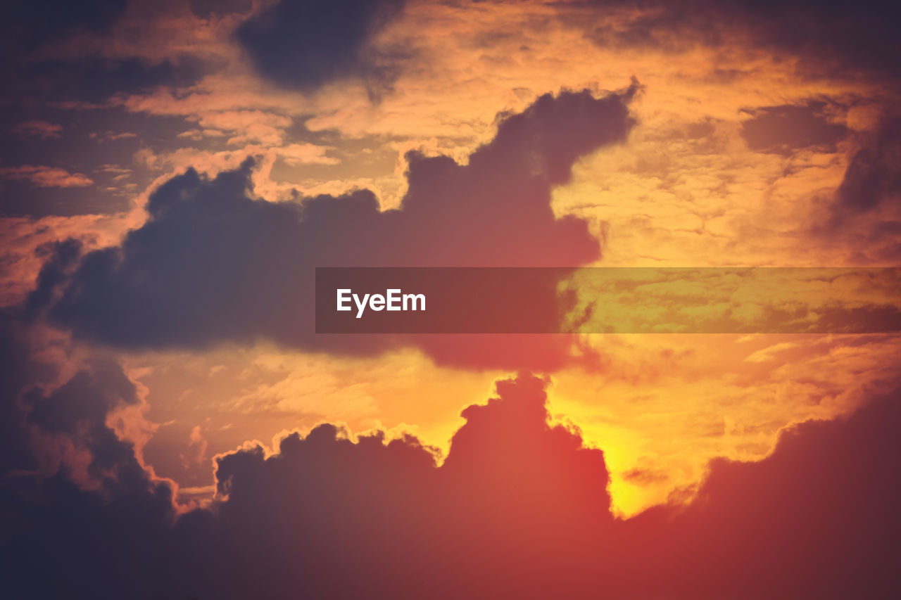 cloud - sky, sky, sunset, beauty in nature, scenics - nature, orange color, tranquil scene, tranquility, idyllic, nature, low angle view, no people, backgrounds, cloudscape, full frame, dramatic sky, silhouette, outdoors, majestic, meteorology, ominous