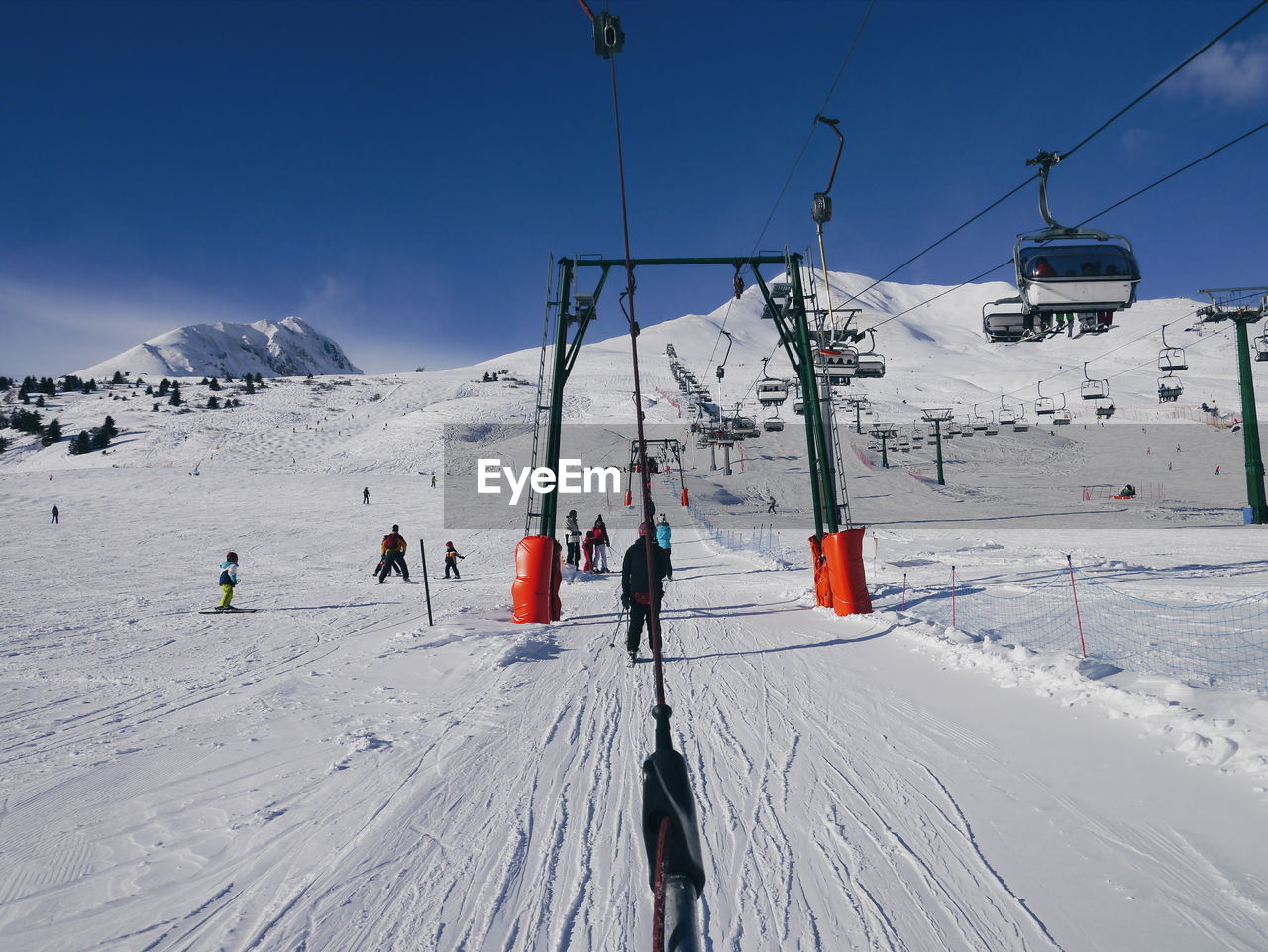 People Skiing On Snow Covered Field