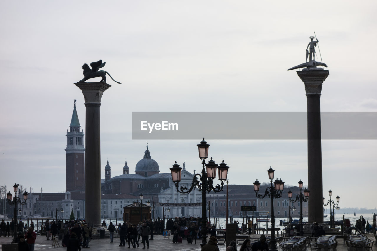 People At Piazza San Marco With San Giorgio Maggiore Against Sky