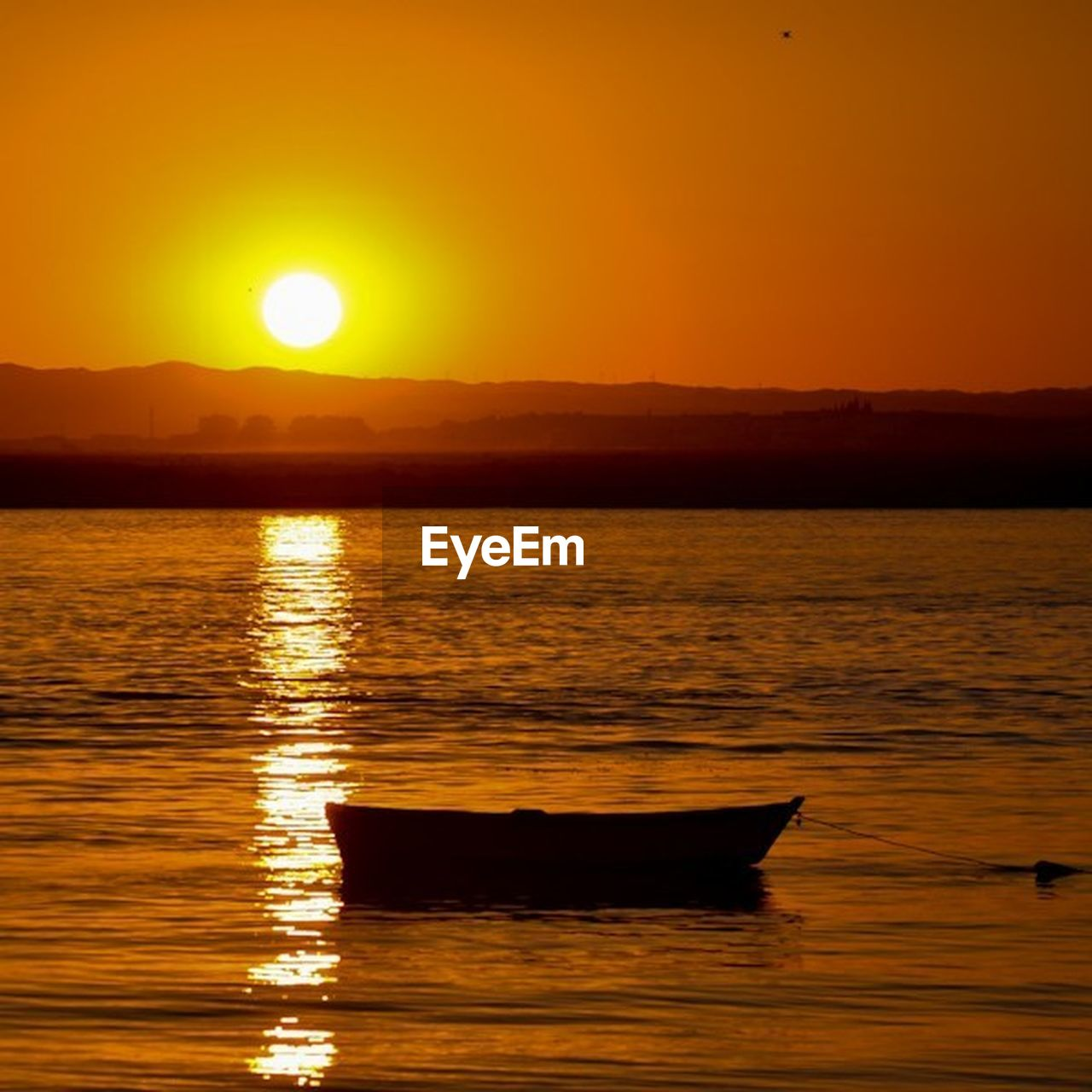 sunset, sun, reflection, orange color, sea, water, nature, scenics, beauty in nature, nautical vessel, tranquil scene, outdoors, silhouette, no people, tranquility, sky, horizon over water, day