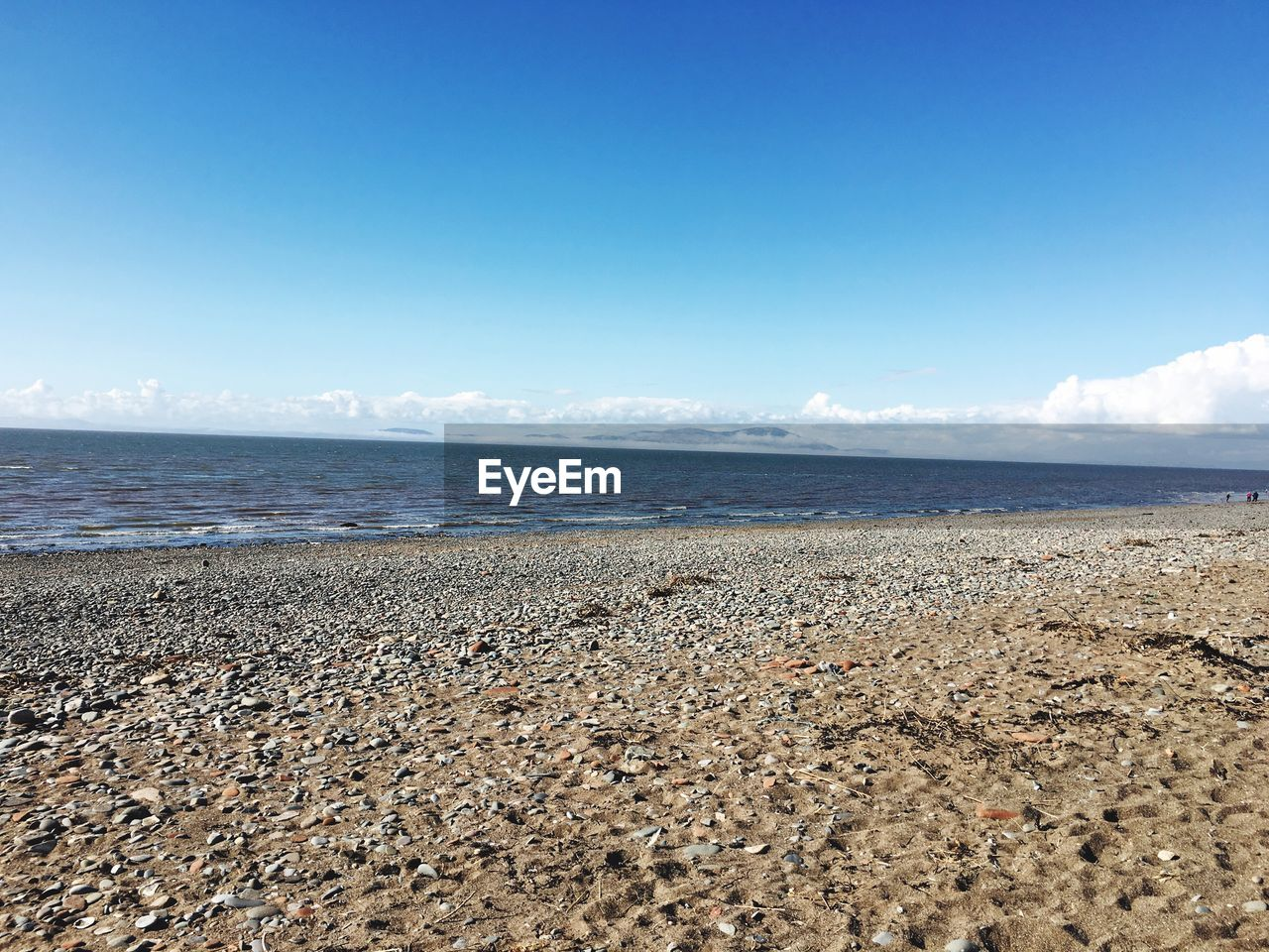 sea, beach, scenics, tranquility, water, nature, beauty in nature, tranquil scene, sky, horizon over water, day, outdoors, blue, no people, sand, pebble beach
