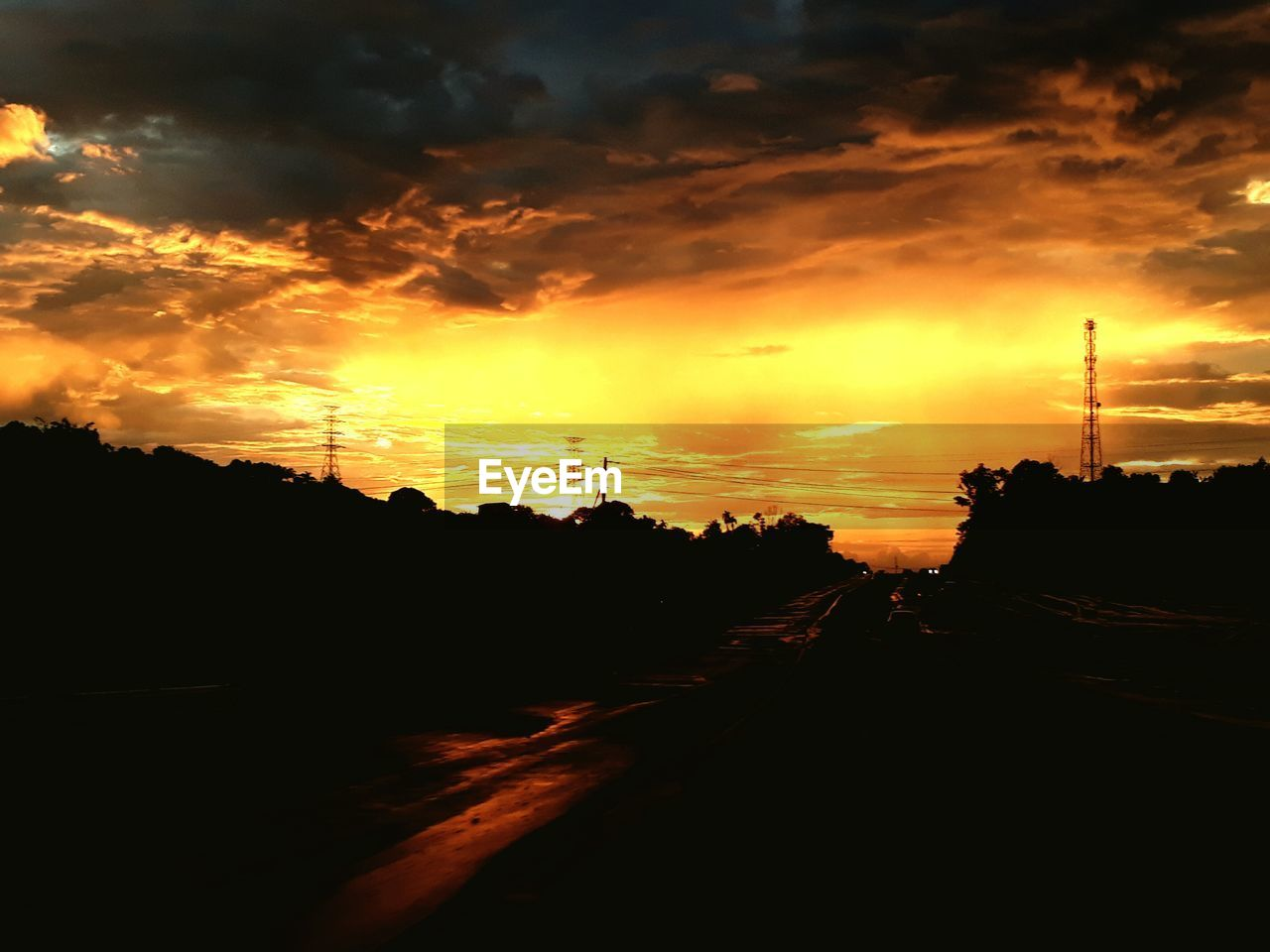sunset, silhouette, sky, orange color, cloud - sky, dramatic sky, road, the way forward, no people, transportation, nature, electricity pylon, scenics, outdoors, electricity, tree, beauty in nature, telephone line