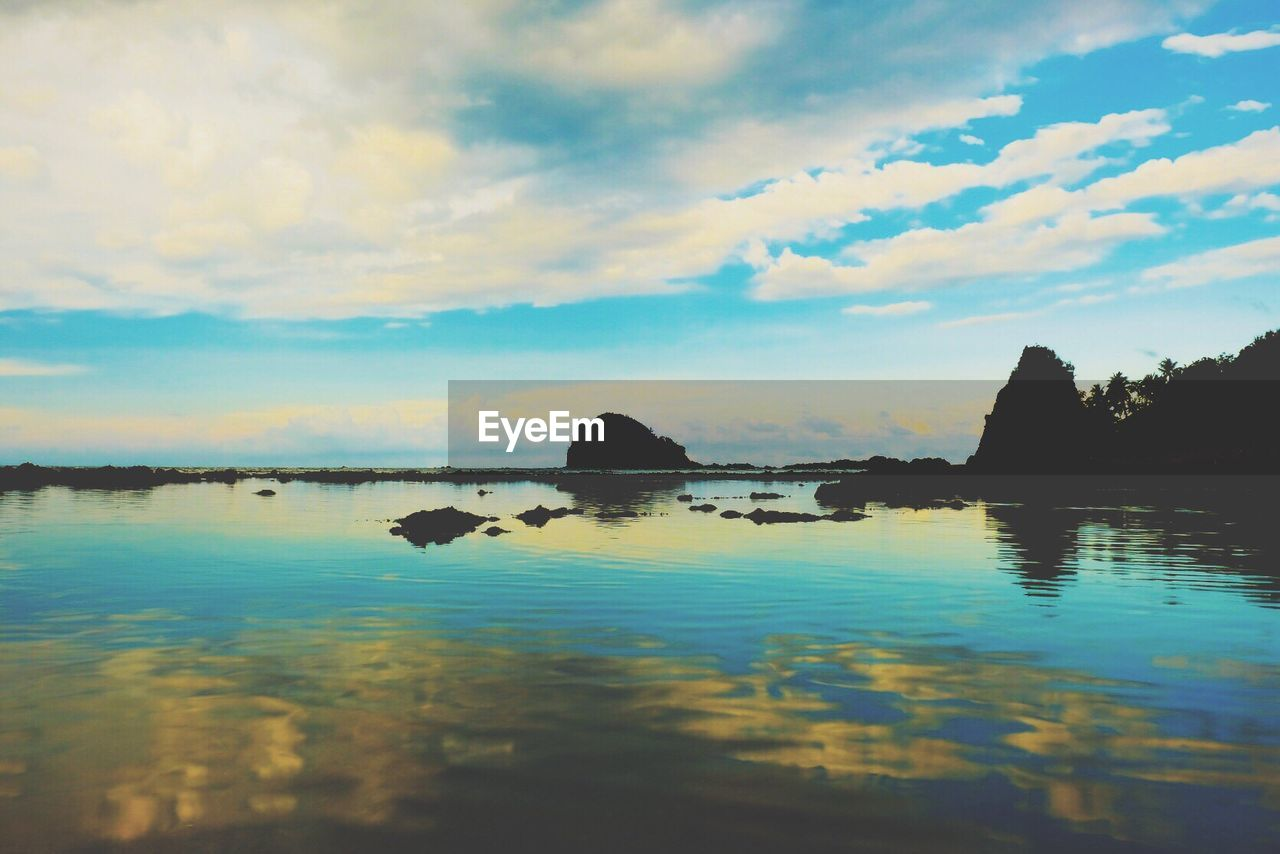 water, sky, nature, reflection, scenics, tranquility, tranquil scene, beauty in nature, sea, rock - object, outdoors, no people, cloud - sky, sunset, mountain, day
