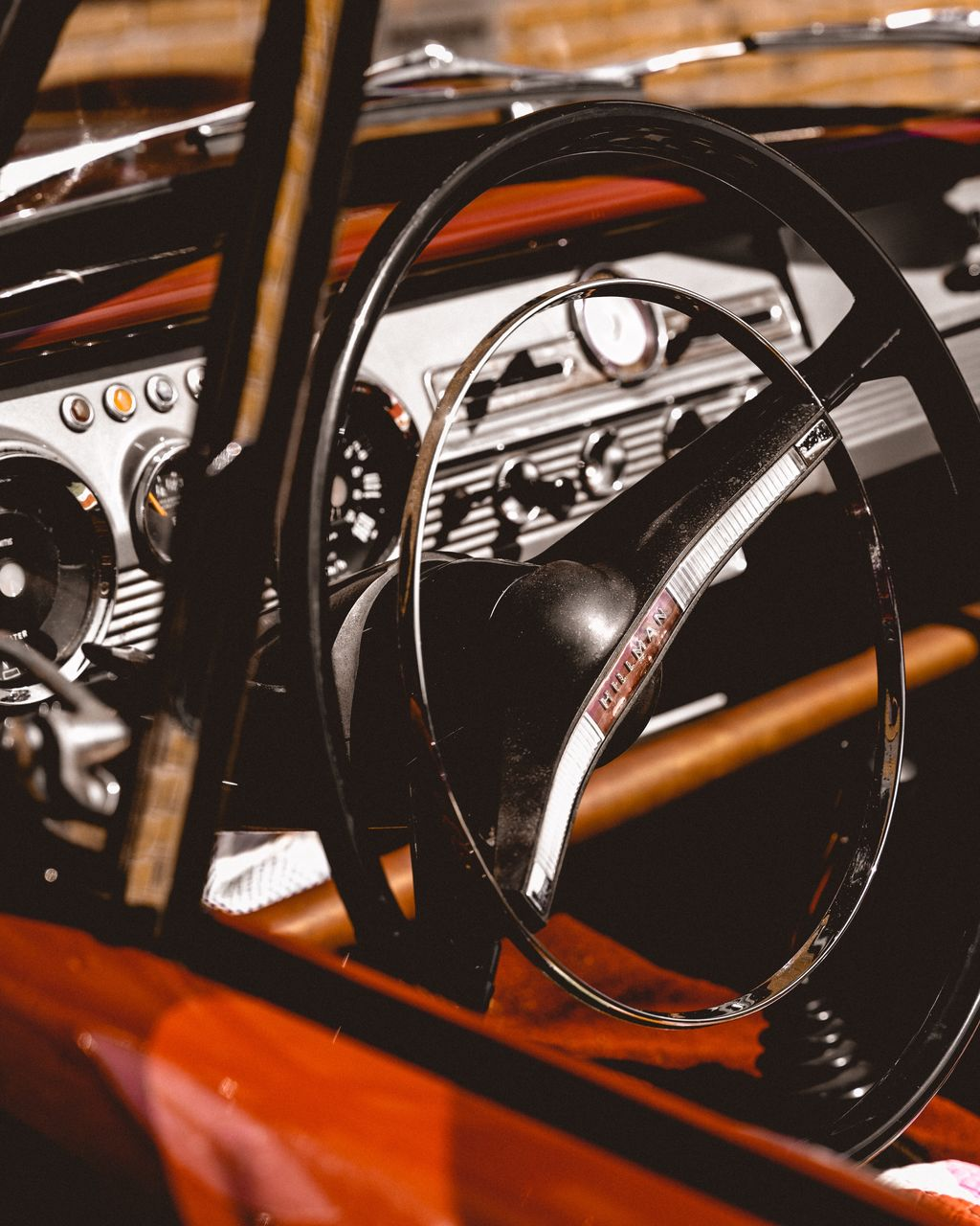 car, motor vehicle, close-up, land vehicle, mode of transportation, vehicle interior, transportation, indoors, car interior, control panel, no people, steering wheel, dashboard, glass - material, number, speedometer, black color, selective focus, metal, focus on foreground, luxury