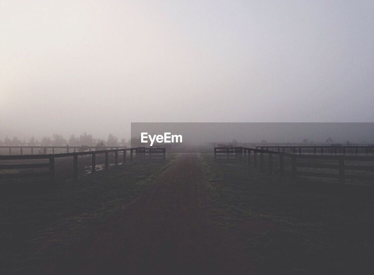 fog, landscape, field, tranquility, outdoors, tranquil scene, no people, day, nature, scenics, grass, sky, beauty in nature