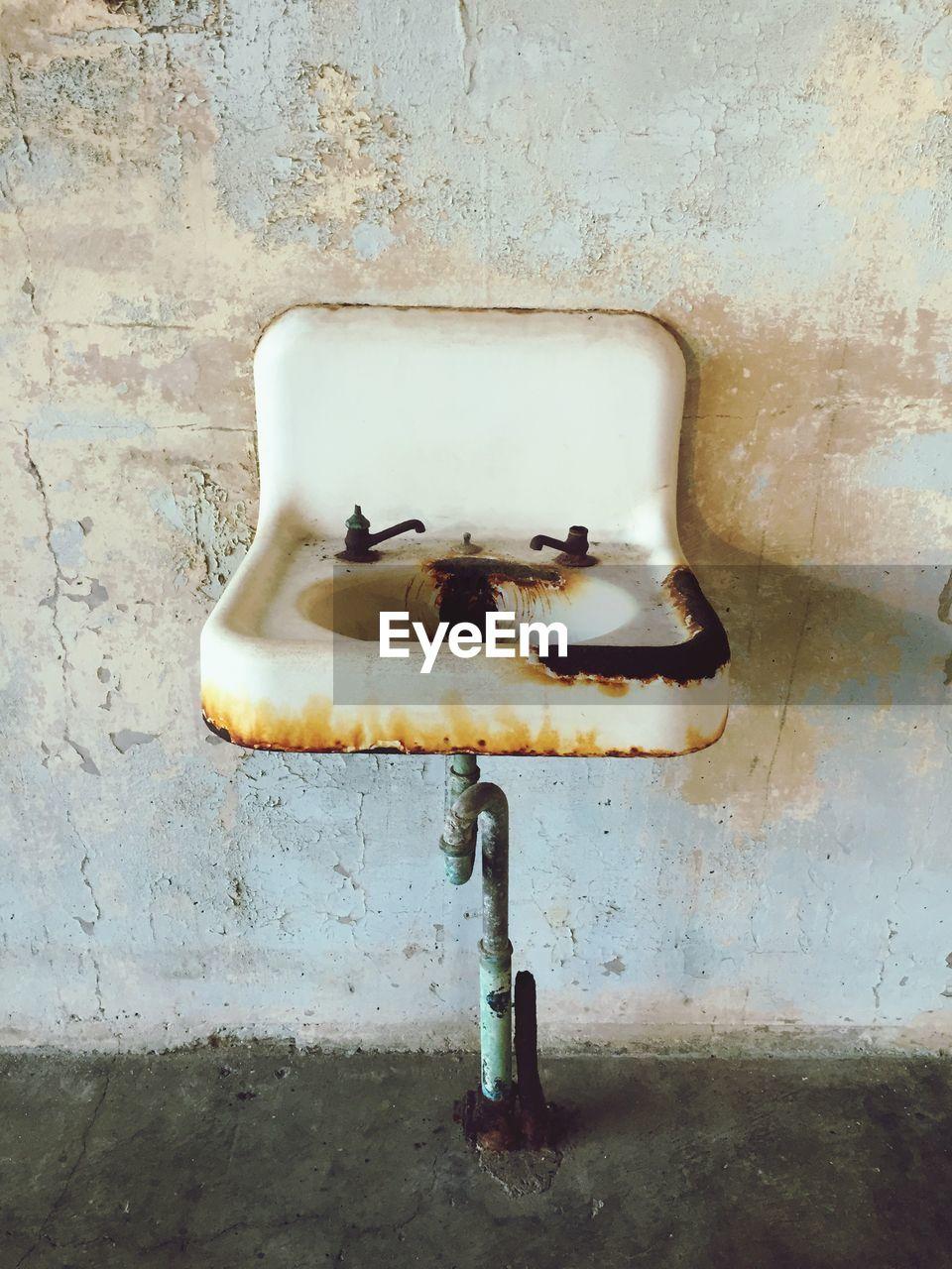 Abandoned sink on wall