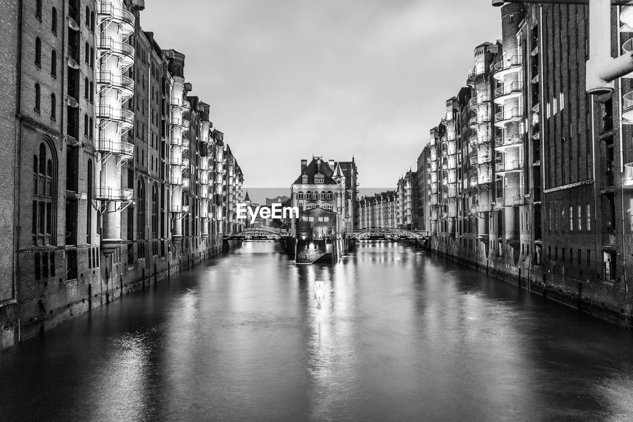 architecture, built structure, building exterior, canal, waterfront, water, sky, reflection, no people, day, residential building, outdoors, travel destinations, nautical vessel, city, gondola - traditional boat