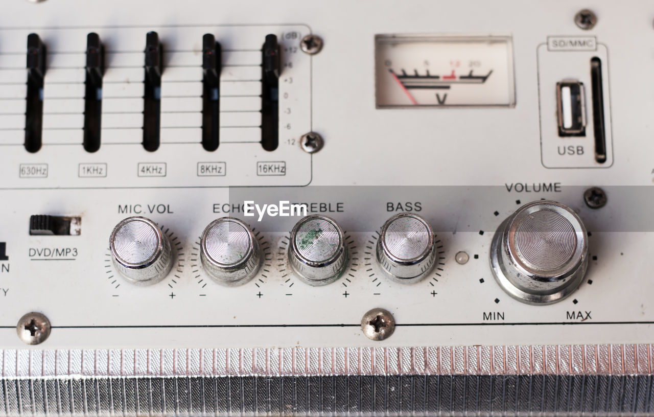 control panel, technology, knob, control, equipment, text, no people, close-up, indoors, western script, button, full frame, large group of objects, side by side, gauge, metal, in a row, switch, lever, electricity, electrical component, push button, meter - instrument of measurement, electrical equipment, silver colored