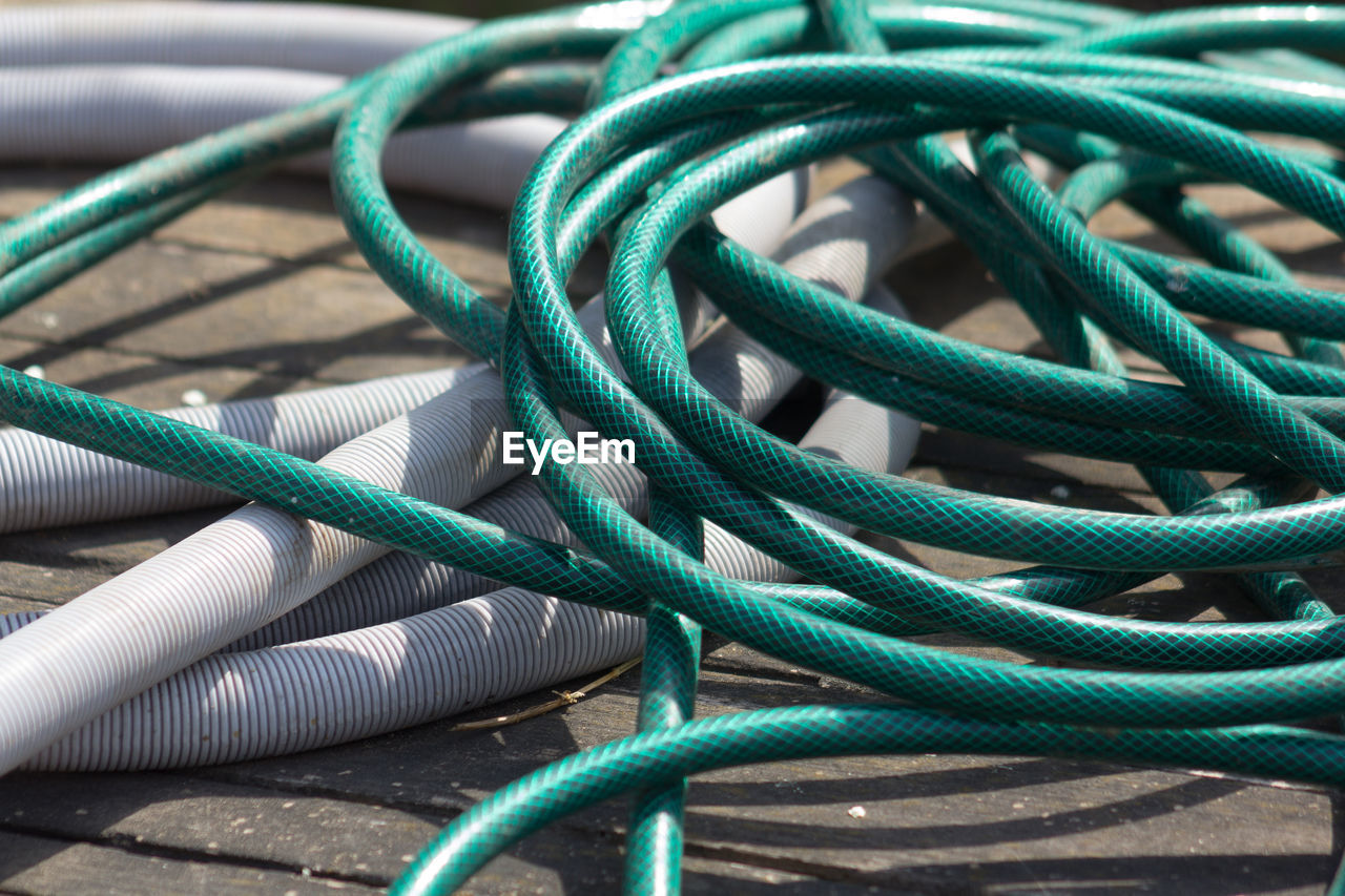 connection, green color, cable, equipment, tangled, close-up, no people, complexity, outdoors, day
