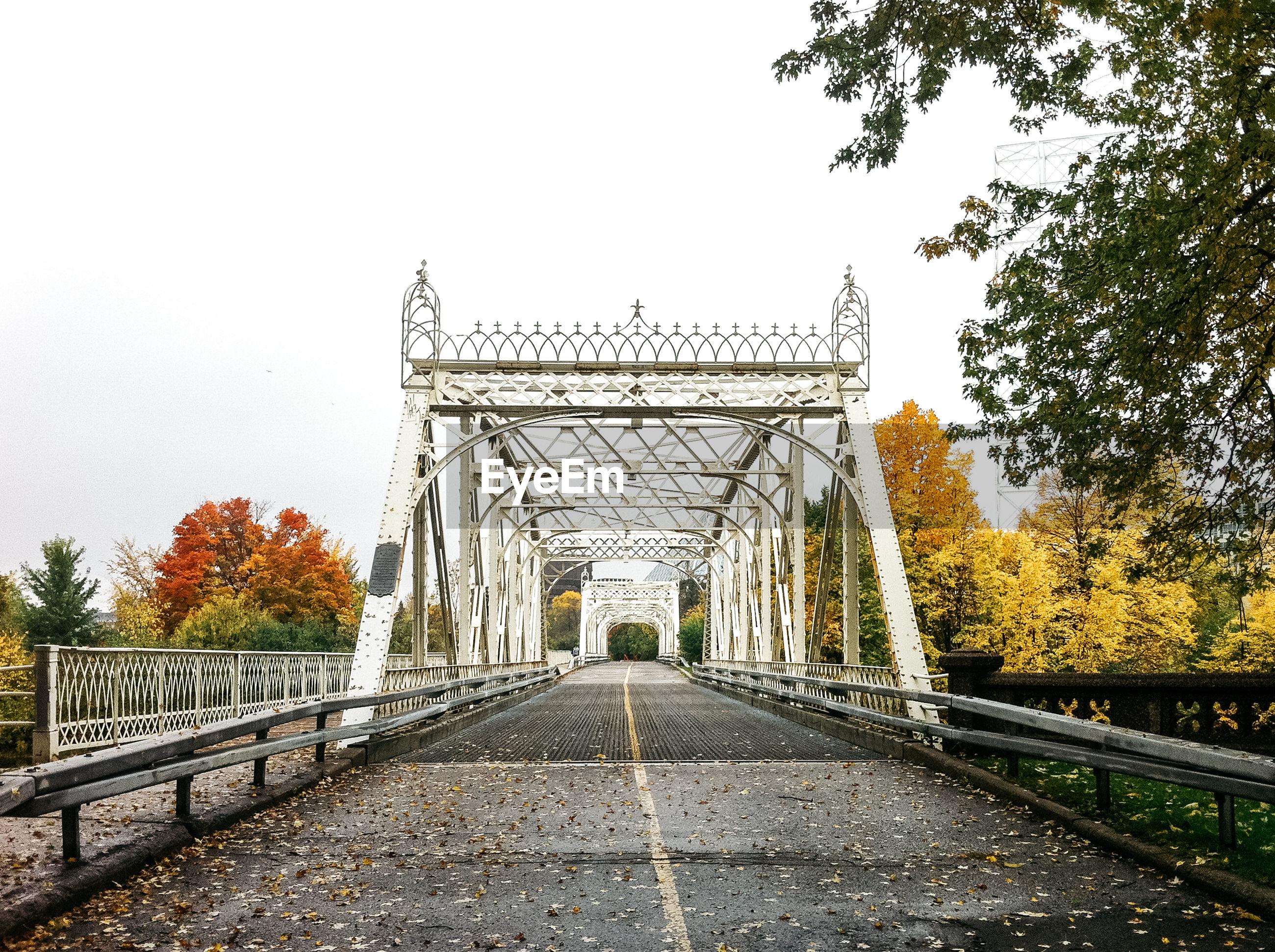 Metallic bridge against sky