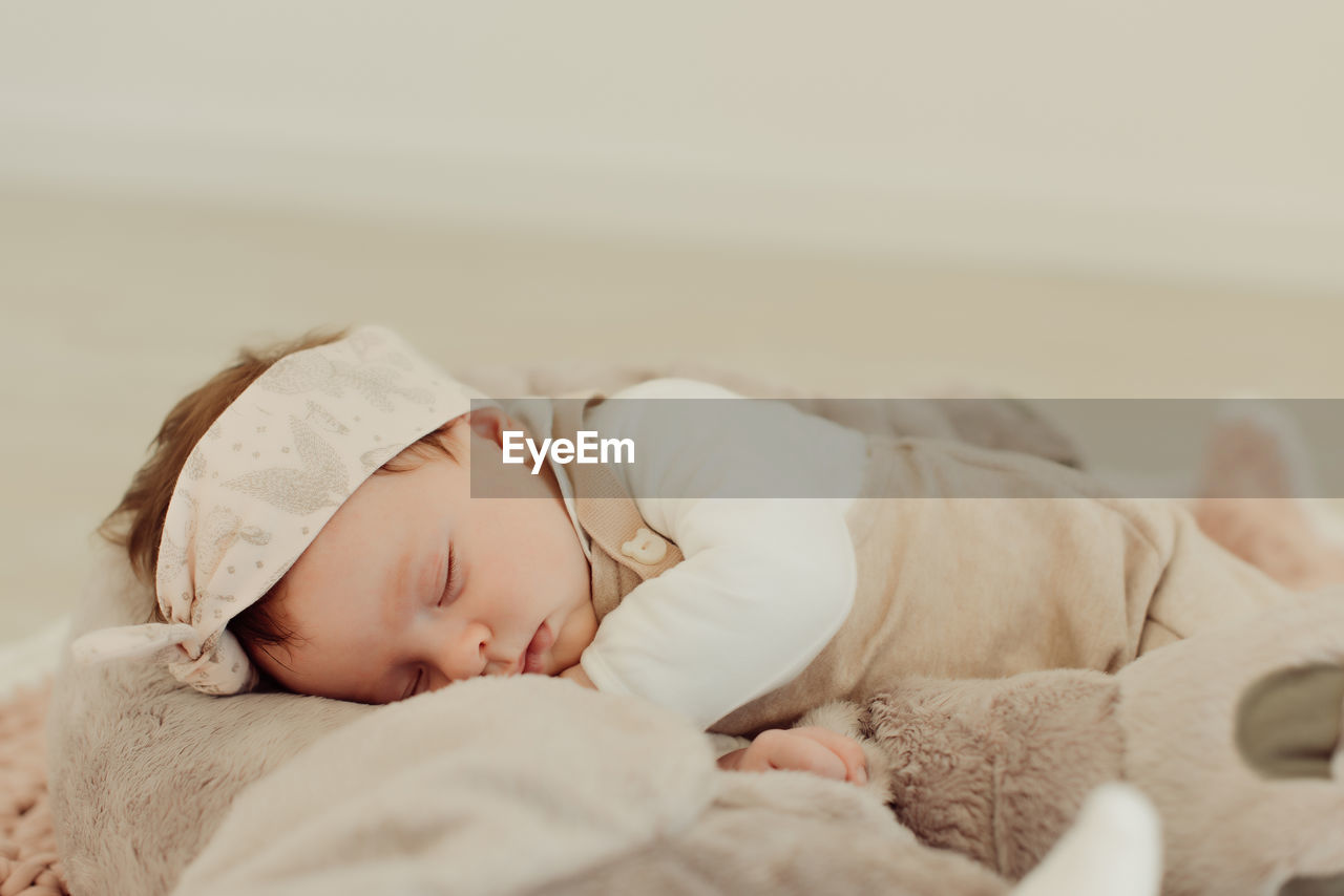 child, childhood, relaxation, sleeping, lying down, bed, eyes closed, furniture, real people, one person, baby, innocence, young, babyhood, resting, indoors, cute, headshot