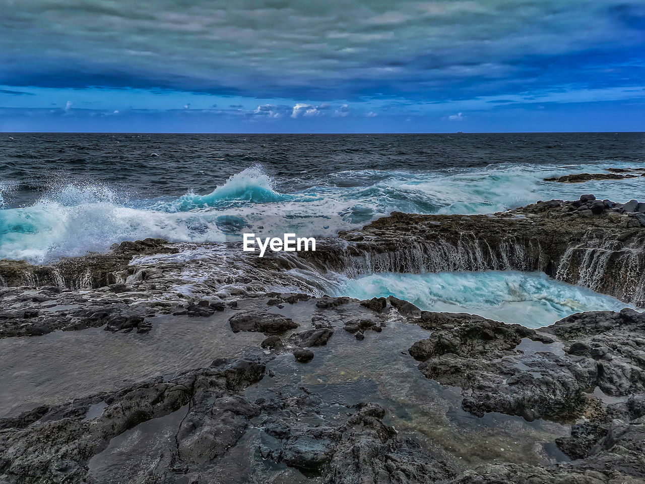 sky, water, sea, beauty in nature, scenics - nature, cloud - sky, rock, motion, beach, solid, nature, horizon over water, rock - object, land, horizon, no people, tranquility, tranquil scene, day, outdoors, power in nature