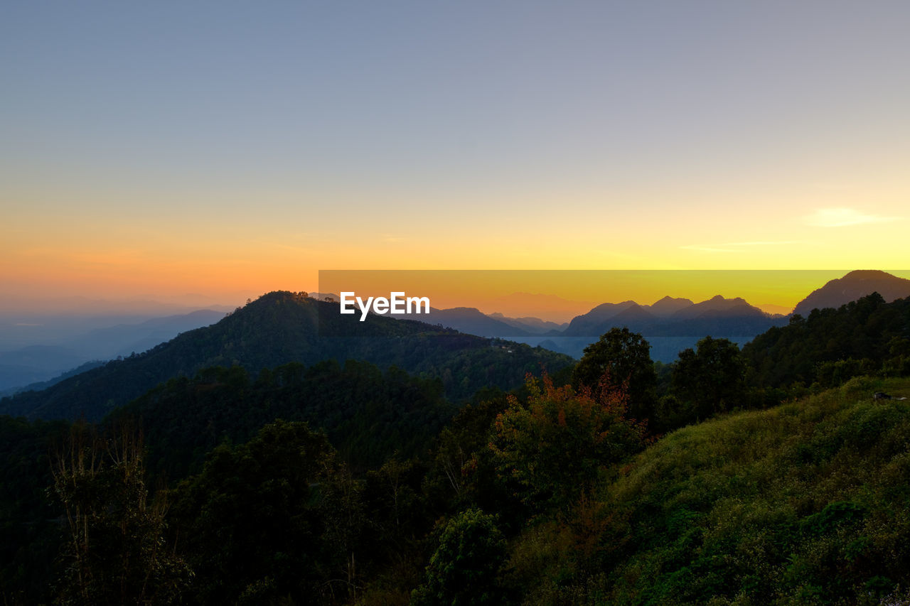 sky, beauty in nature, scenics - nature, mountain, sunset, tranquility, tranquil scene, tree, non-urban scene, idyllic, orange color, plant, mountain range, nature, environment, landscape, no people, copy space, outdoors, silhouette