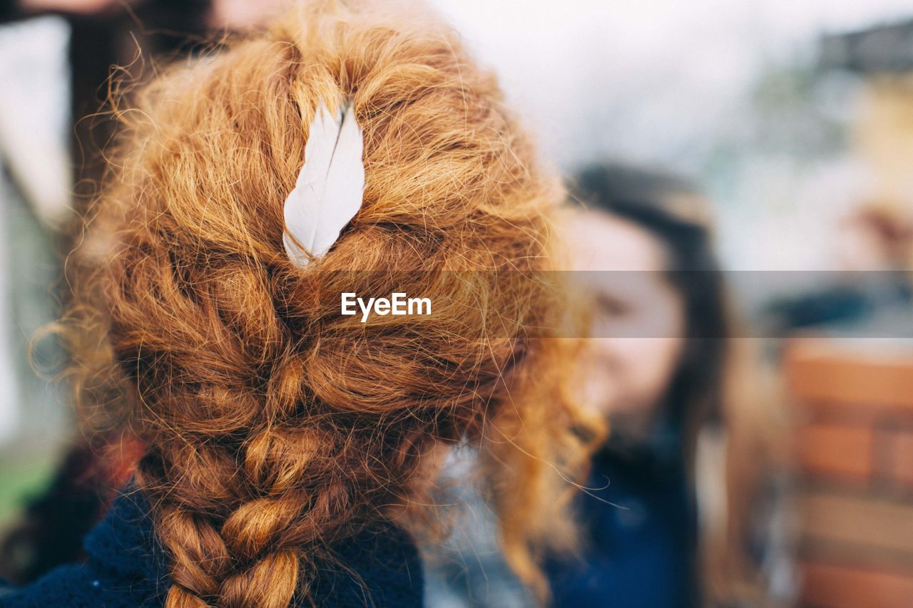 Rear View Of Redhead Girl With Braided Hair
