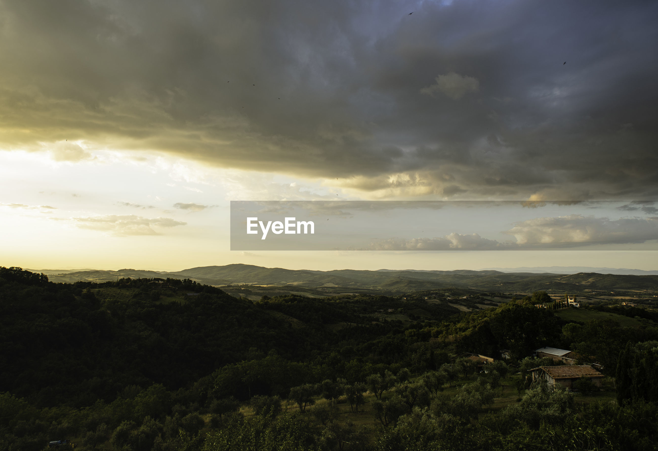 SCENIC VIEW OF LAND AGAINST SKY DURING SUNSET