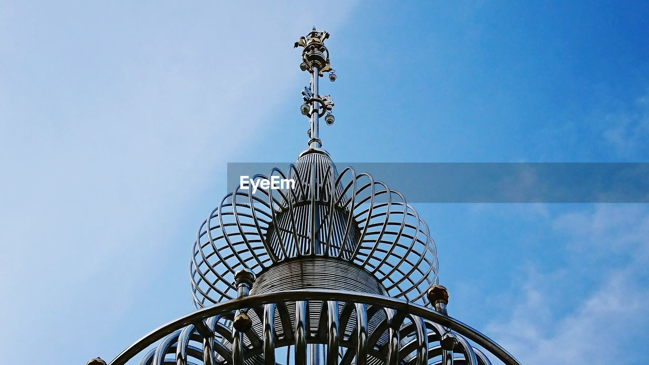 sky, low angle view, architecture, built structure, nature, day, no people, metal, pattern, outdoors, travel, blue, building exterior, high section, art and craft, clear sky, design, arch, weather vane