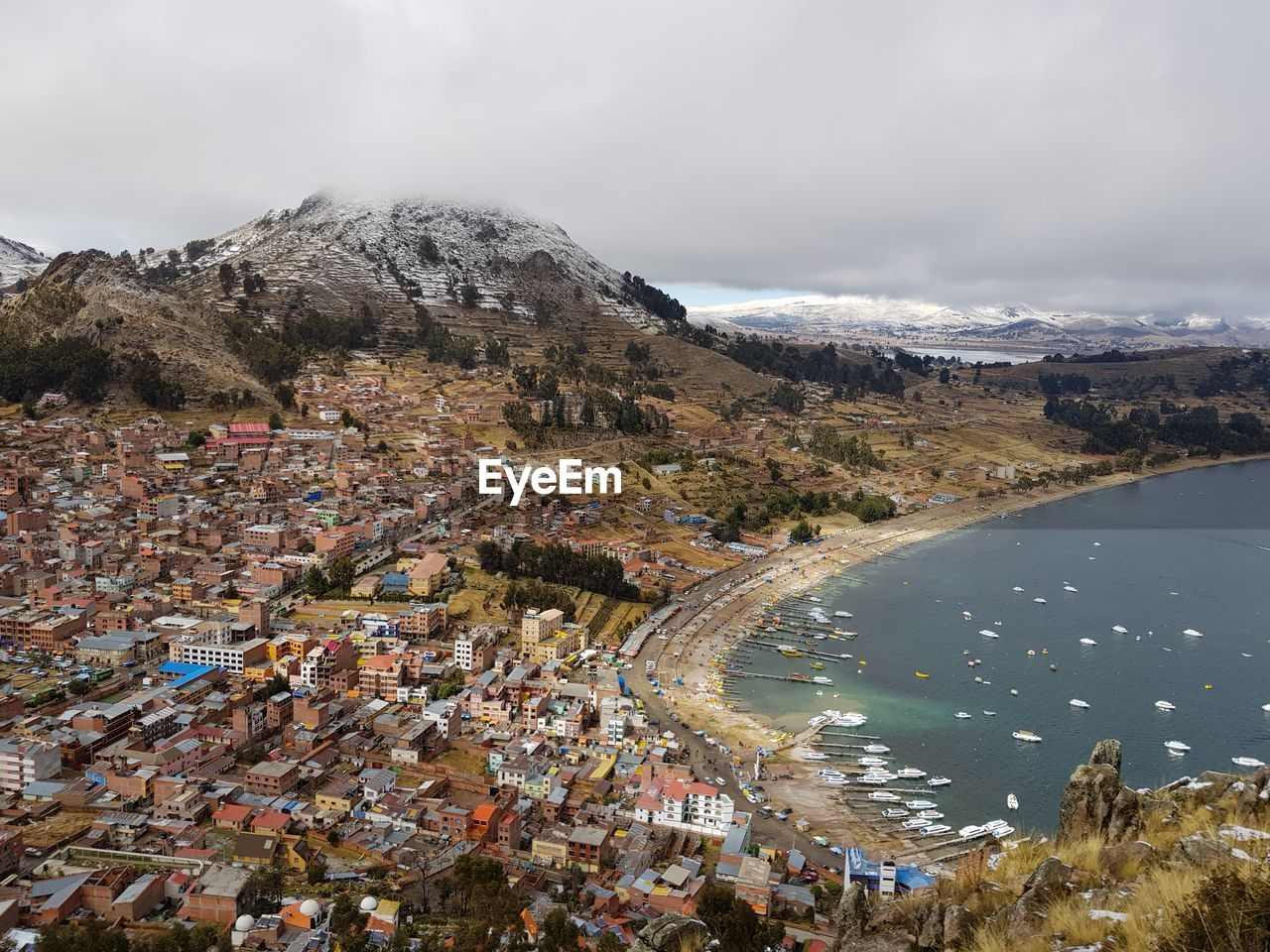 High angle view of lake titicaca and city against sky