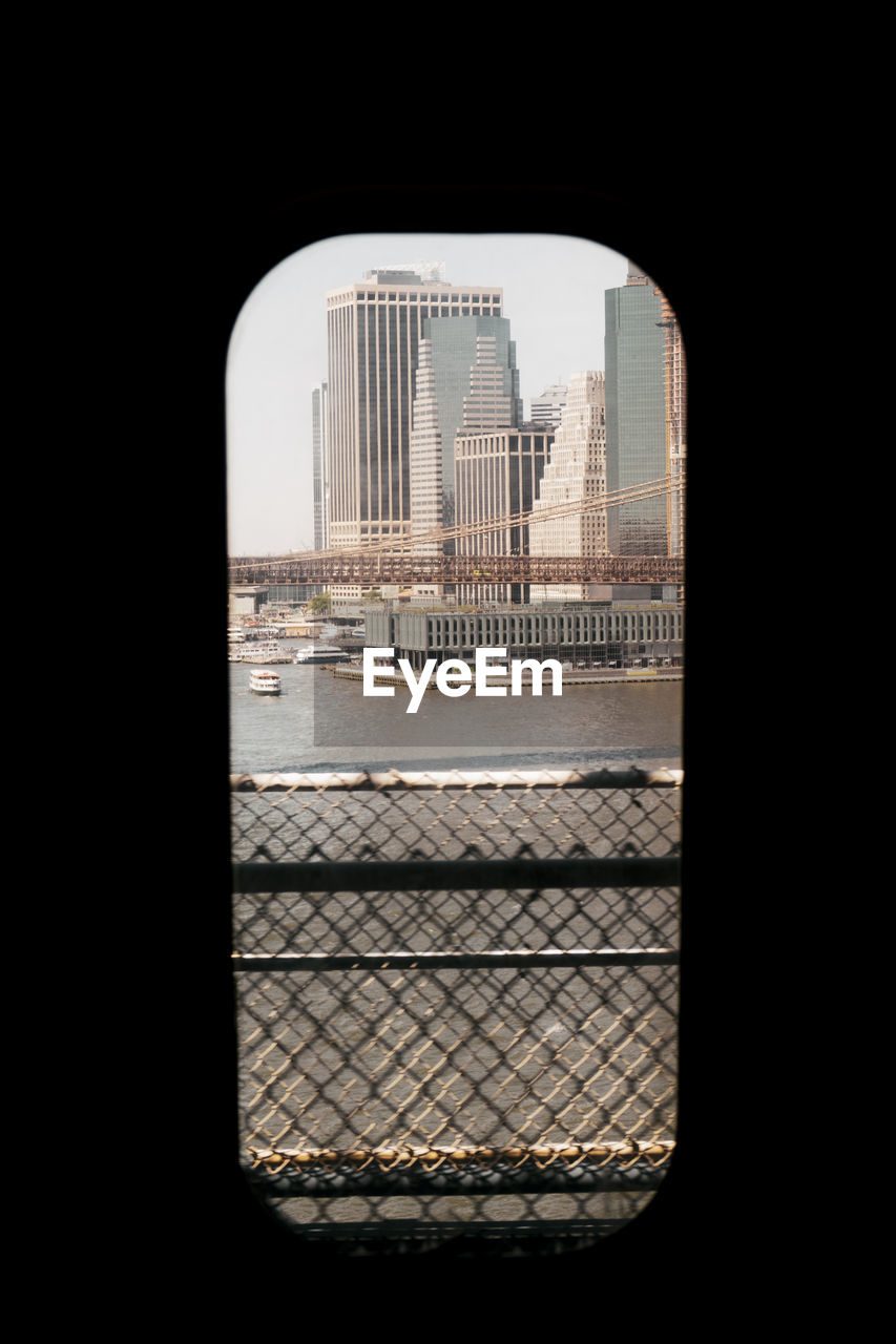 Buildings in city seen through window