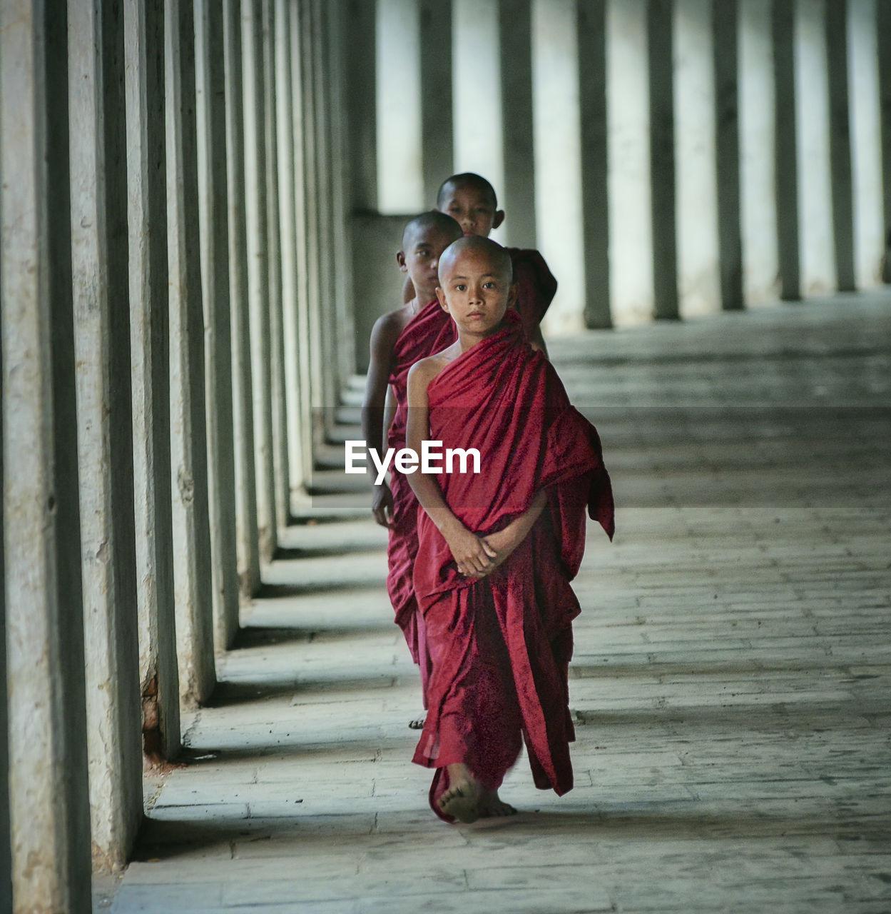 Monks walking in temple