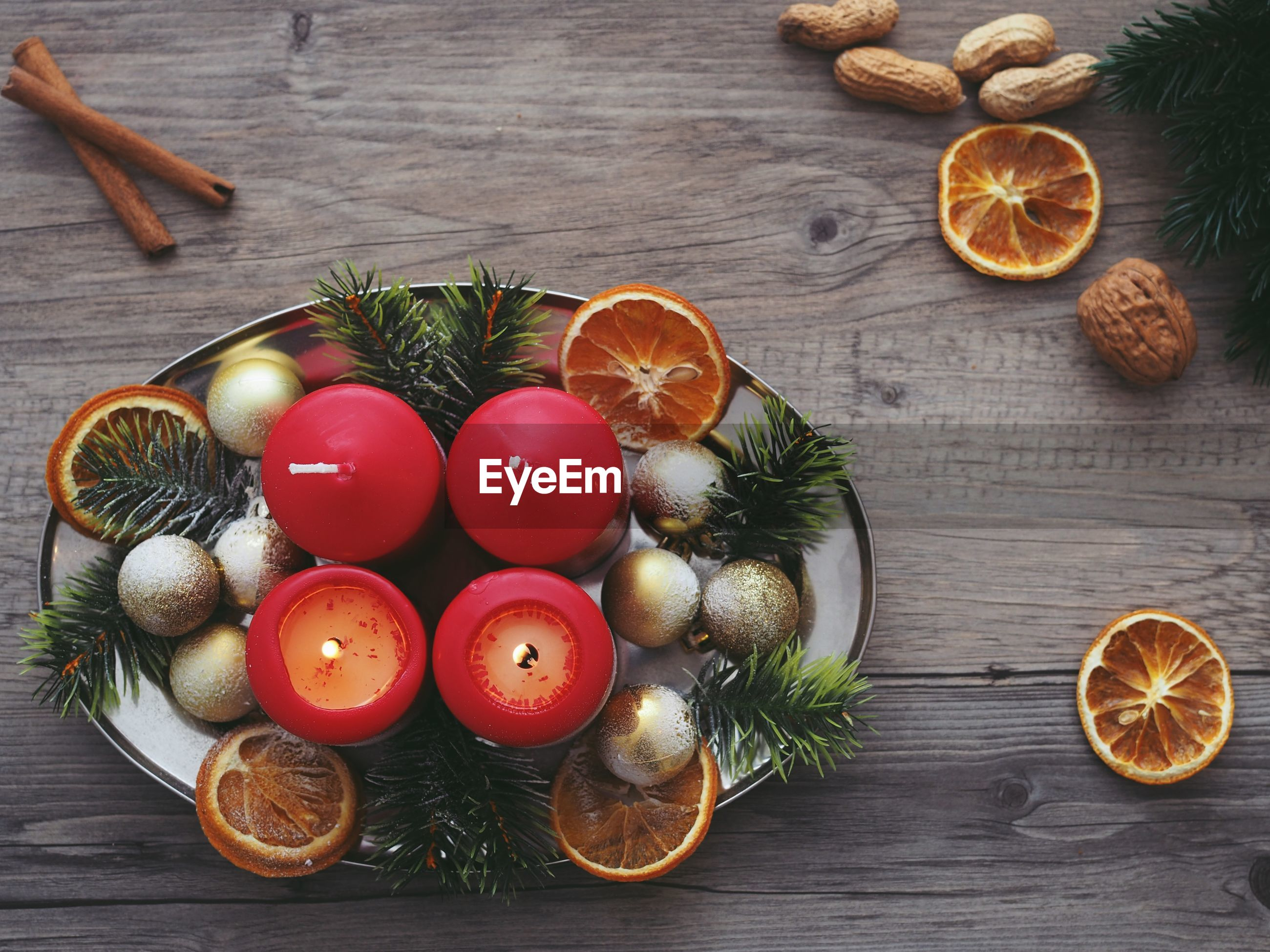 Directly above shot of christmas decorations in plate in wooden table