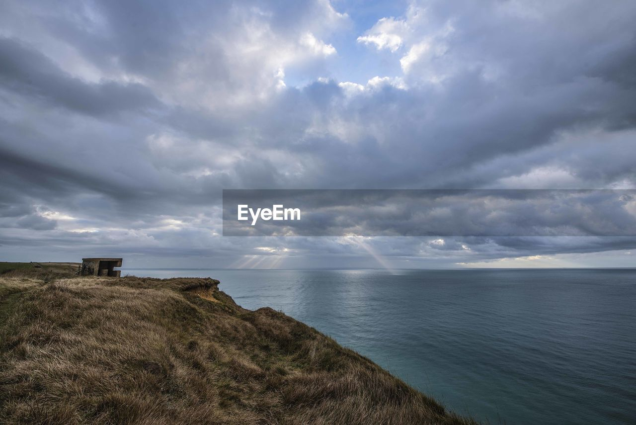 sea, horizon over water, cloud - sky, nature, scenics, tranquil scene, tranquility, sky, beauty in nature, water, no people, day, outdoors, grass, landscape