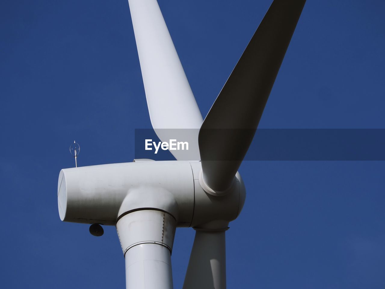 sky, blue, low angle view, no people, day, clear sky, nature, technology, outdoors, sunlight, metal, architecture, air vehicle, copy space, white color, security, industry, mode of transportation, sunny, turbine, aerospace industry