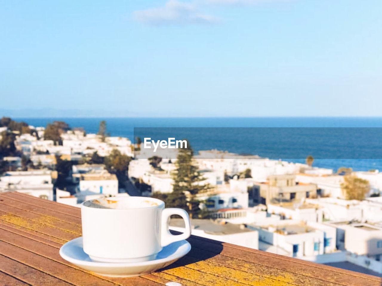 COFFEE BY SEA AGAINST SKY