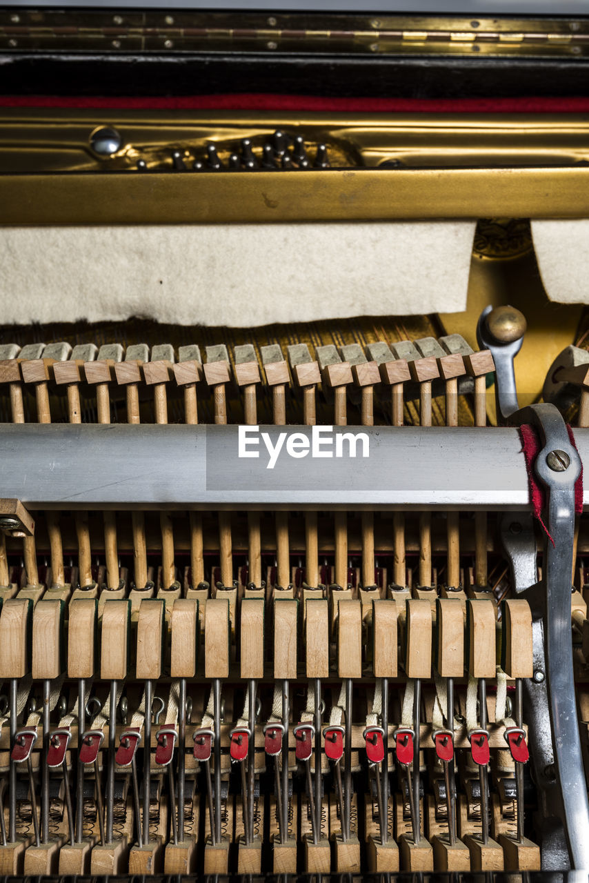 no people, technology, large group of objects, piano, abundance, in a row, wood - material, old, musical equipment, indoors, typewriter, close-up, musical instrument, high angle view, communication, industry, antique, business, music