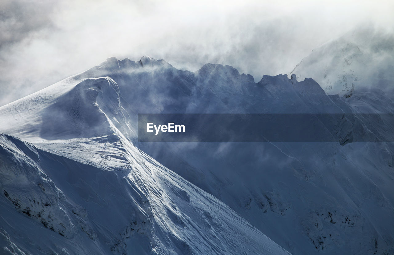 View Of Snowcapped Mountains Against Sky