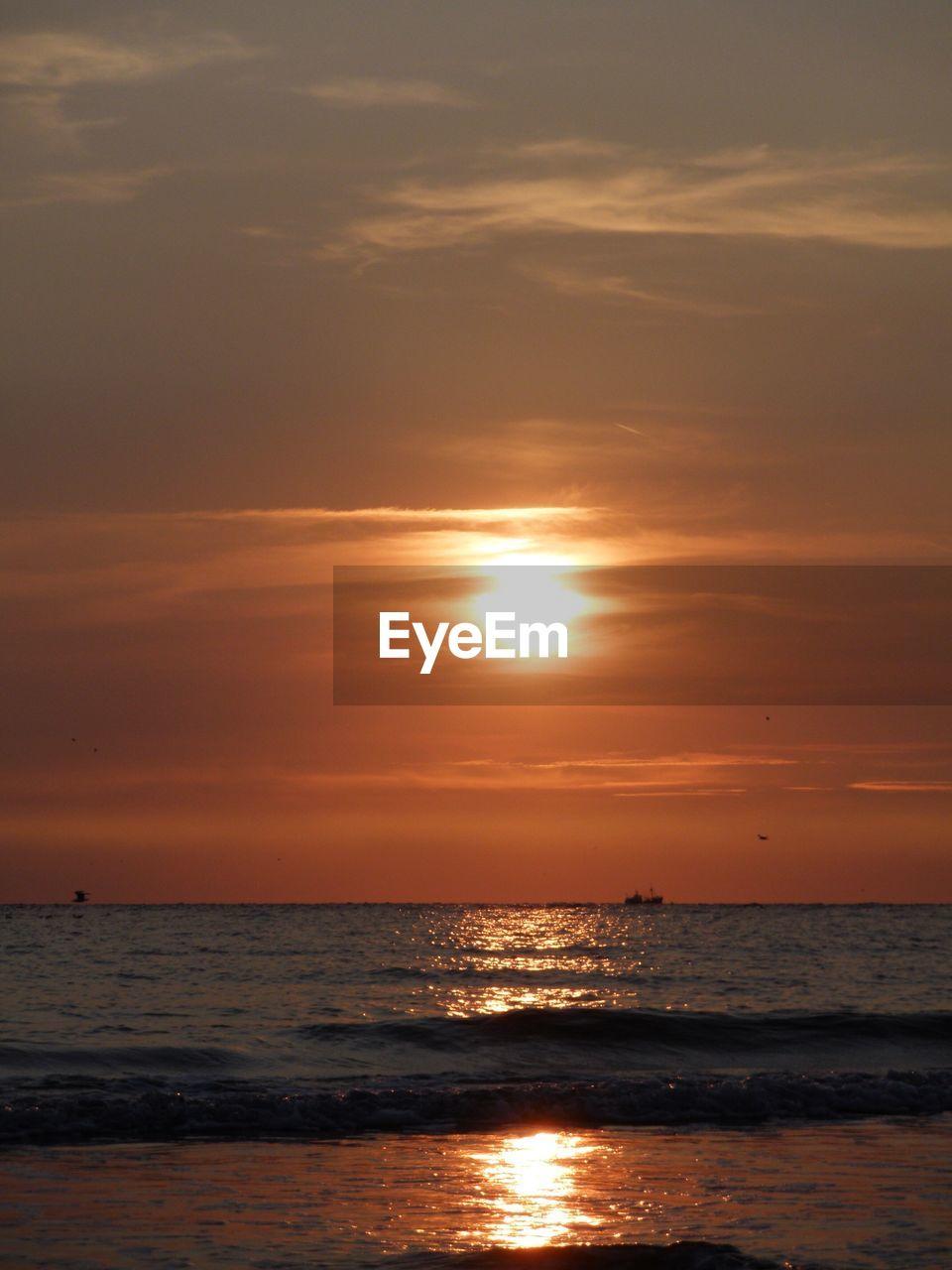 sky, sunset, sea, water, scenics - nature, horizon, horizon over water, beauty in nature, cloud - sky, land, tranquil scene, orange color, sun, tranquility, beach, nature, idyllic, outdoors, non-urban scene, no people